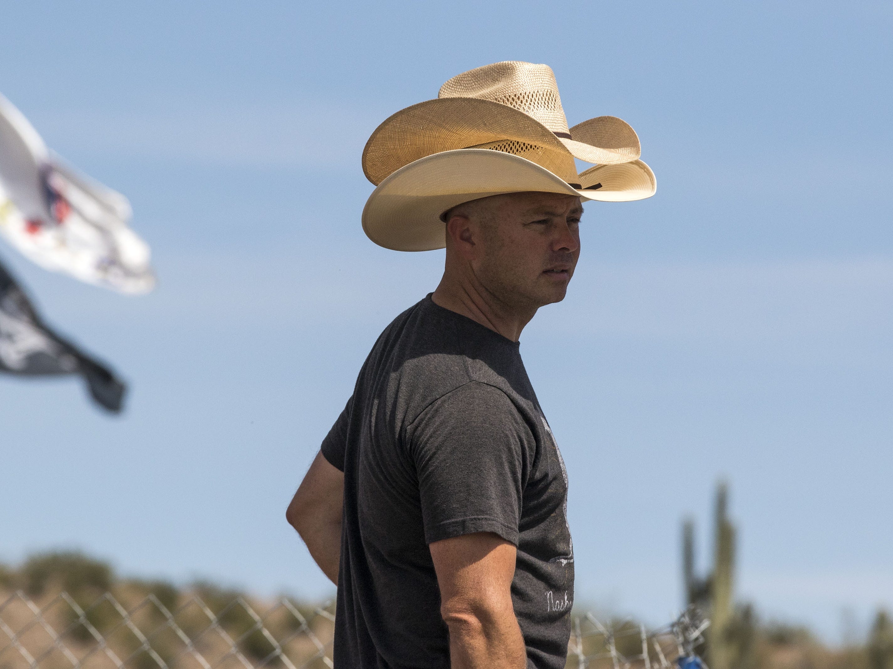 Mike Eaton of Tempe wears two cowboy hats during Country Thunder Arizona on Sunday, April 14, 2019, in Florence, Arizona.