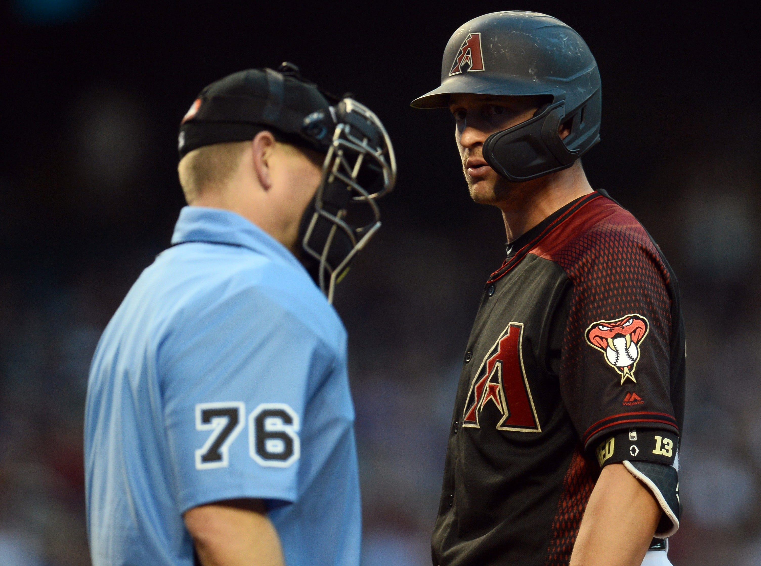 Apr 13, 2019; Phoenix, AZ, USA; Arizona Diamondbacks shortstop Nick Ahmed (13) has words with home plate umpire Mike Muchlinski (76) after being called out on strikes during the fourth inning against the San Diego Padres at Chase Field. Mandatory Credit: Joe Camporeale-USA TODAY Sports