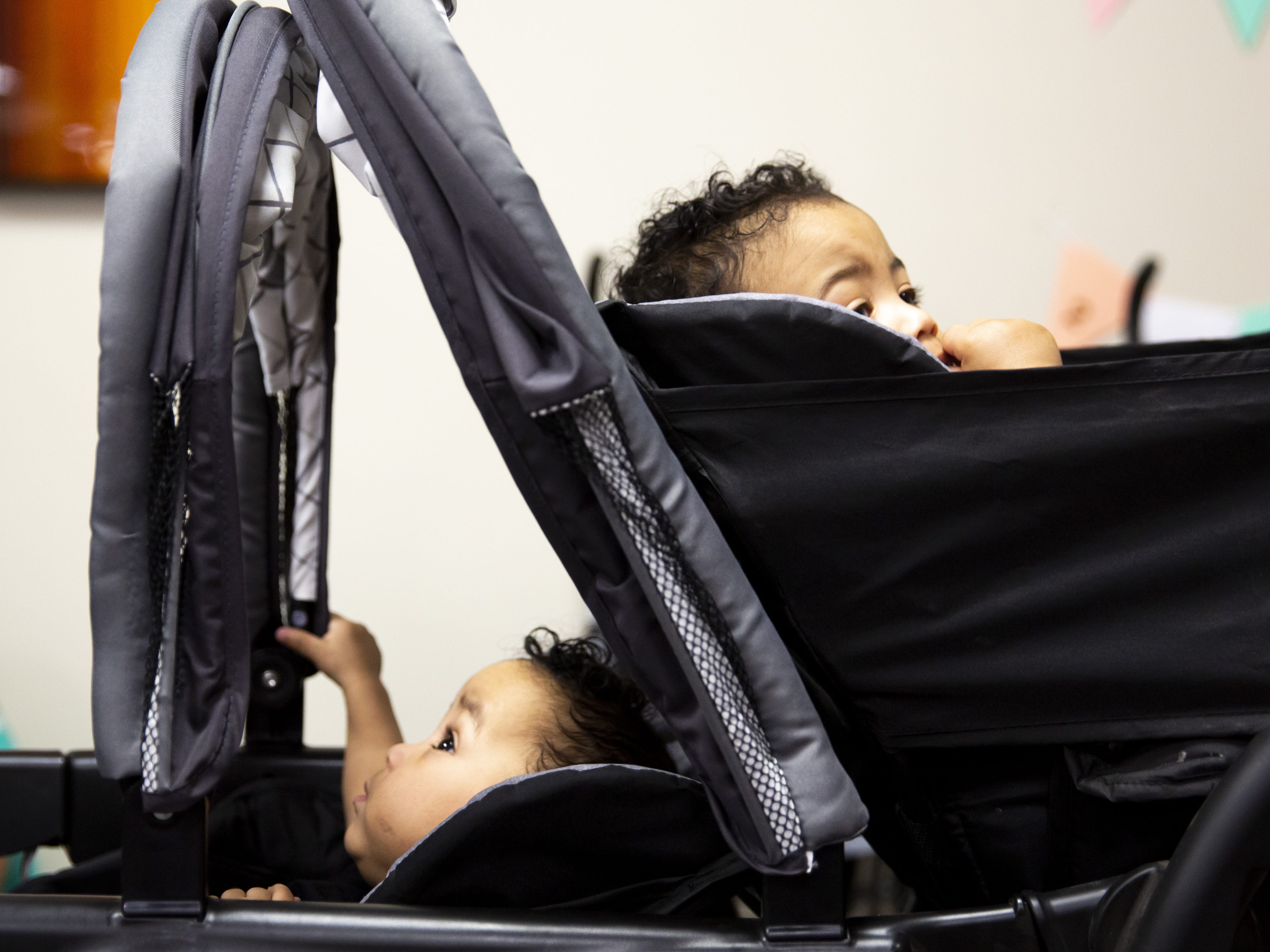 Twins Zandyr, bottom, and Zaidyn, top, peer out of their stroller at the Preemie NICU Reunion at Banner University Medical Center on April 13, 2019. The twins were born on Valentine's Day and spent time in the hospital's NICU.
