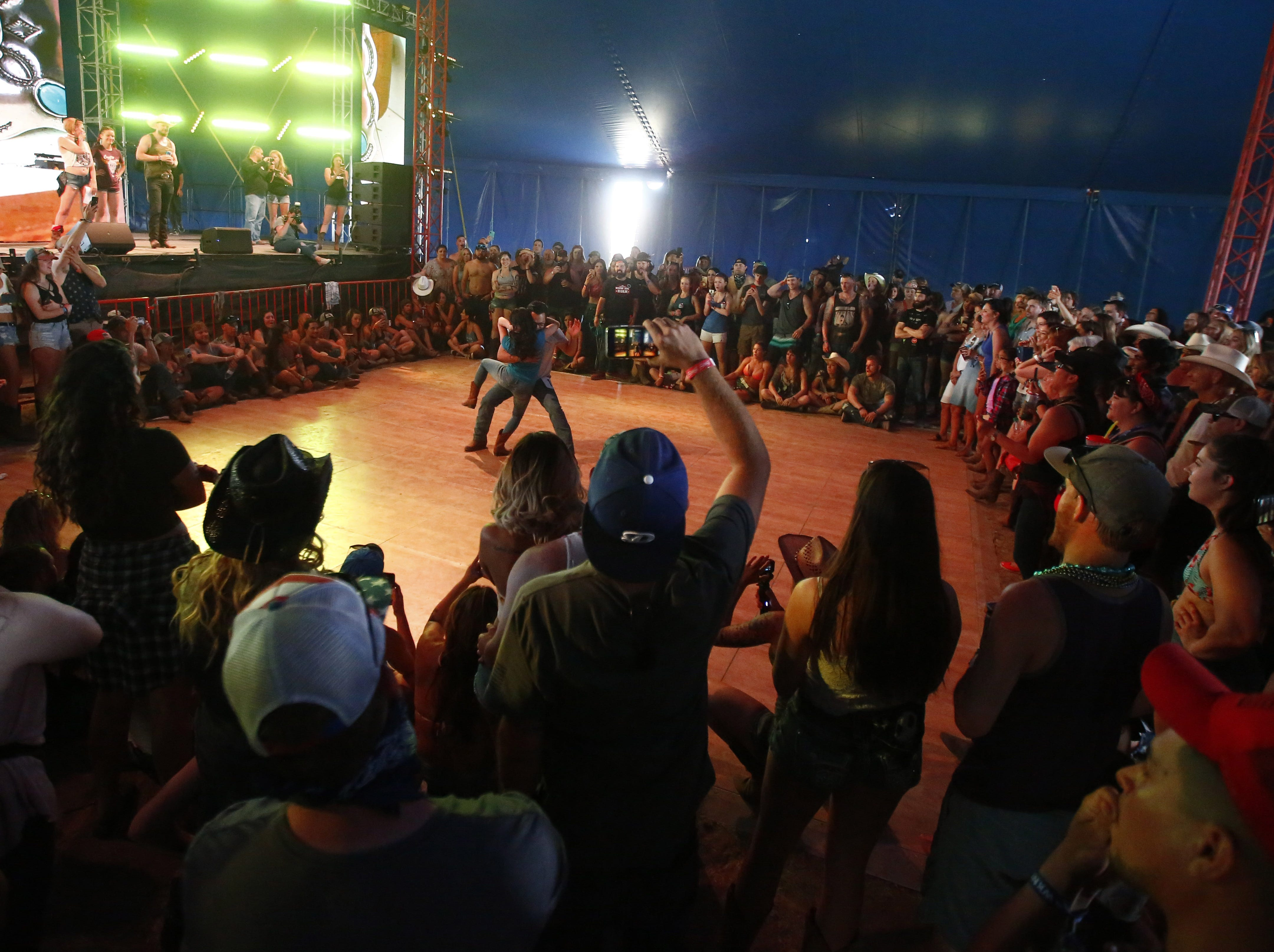 Christine Sanchez dances with Kennedy Wong during the finals of Dancing with the Thunder competition inside the Electric Thunder tent during Country Thunder in Florence, Ariz. on Saturday, April 13, 2019.