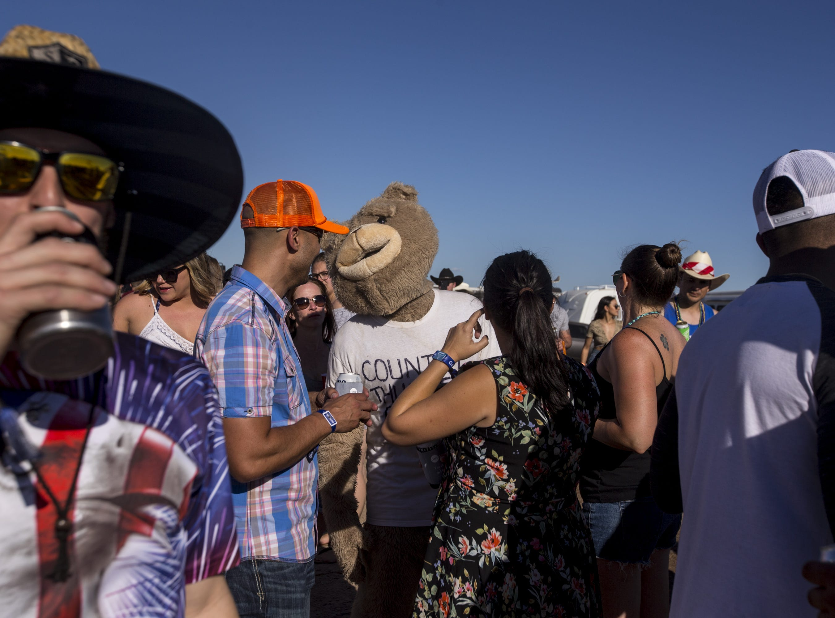 Festival-goers walk around the Crazy Coyote campground on Saturday, April 13, 2019, during Day 3 of Country Thunder Arizona in Florence, Ariz.