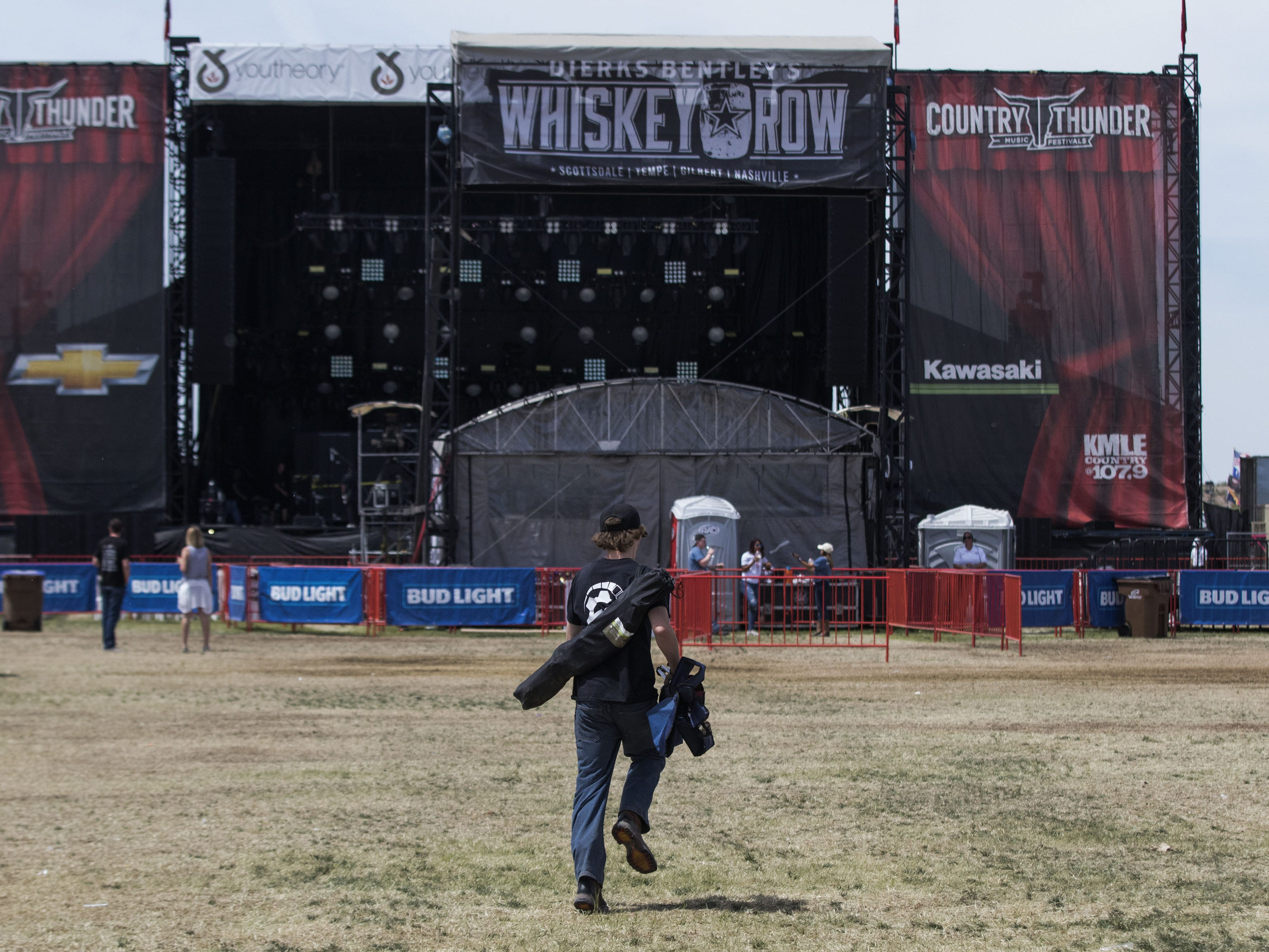 Just after the gates open, a person runs toward the front of the stage during Country Thunder Arizona on Sunday, April 14, 2019, in Florence, Arizona.