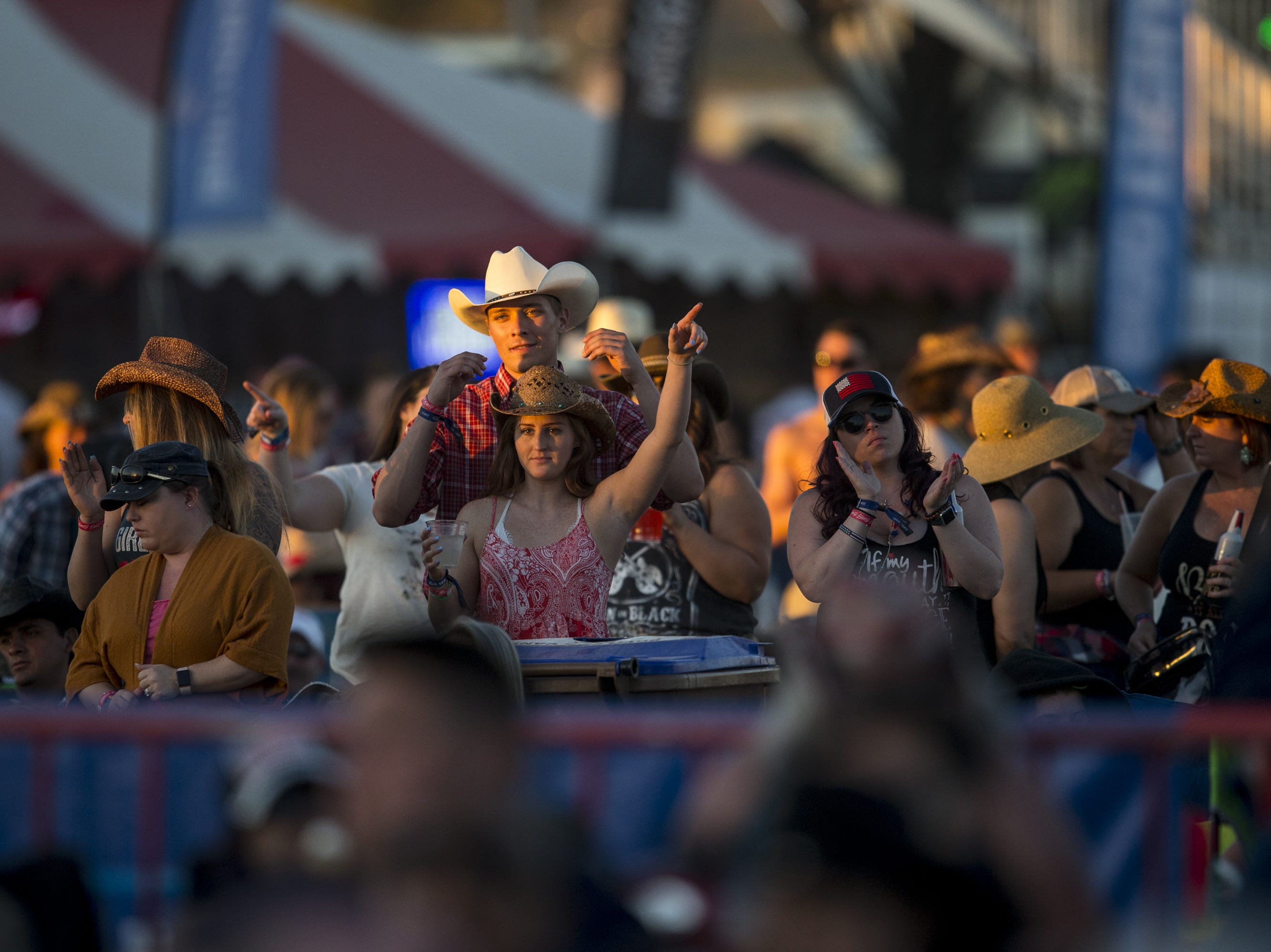 Fans watch Lonestar perform on April 13, 2019, during Day 3 of Country Thunder Arizona in Florence, Arizona.