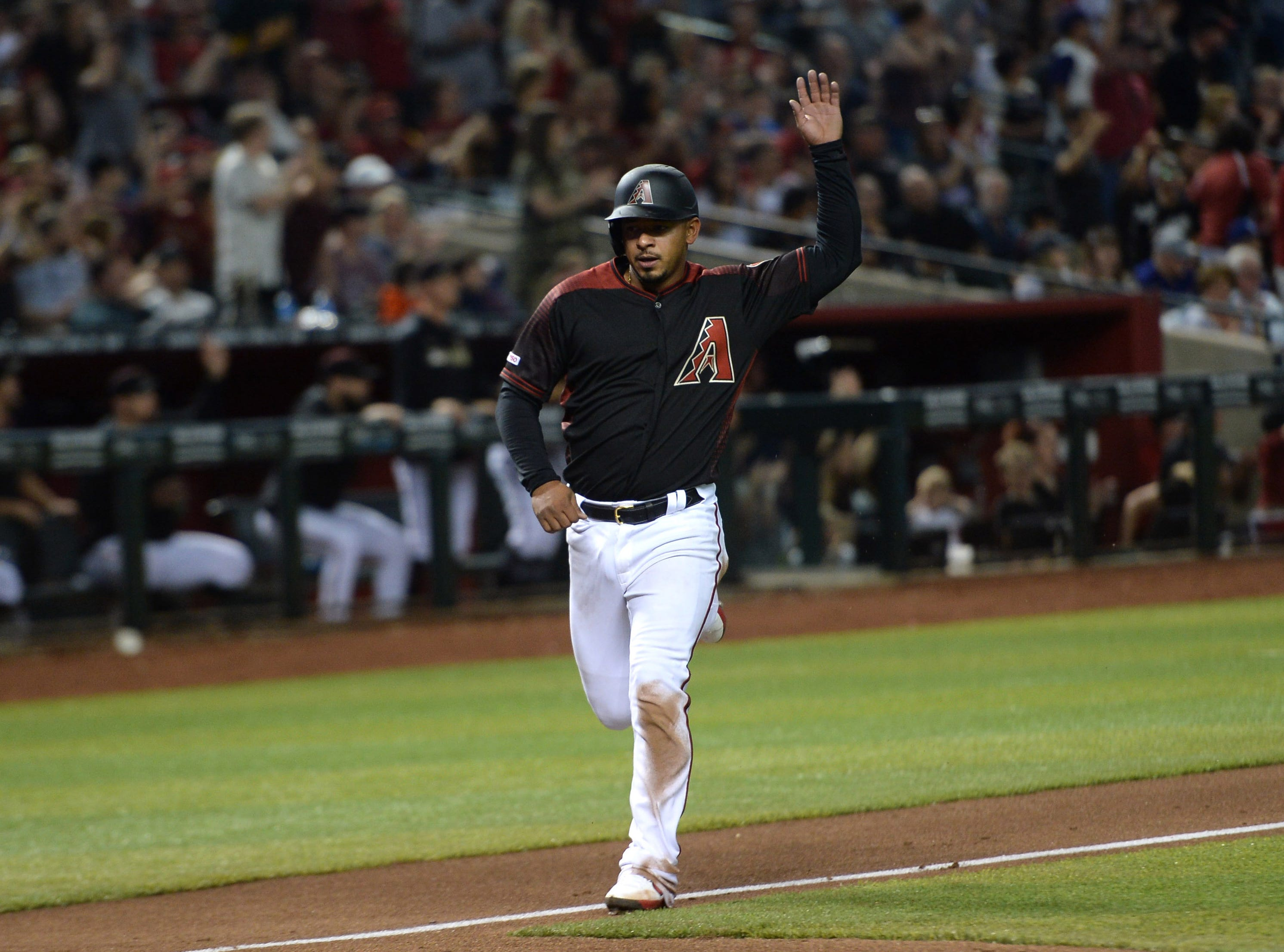 Apr 13, 2019; Phoenix, AZ, USA; Arizona Diamondbacks third baseman Eduardo Escobar (5) scores a run against the San Diego Padres during the sixth inning at Chase Field. Mandatory Credit: Joe Camporeale-USA TODAY Sports