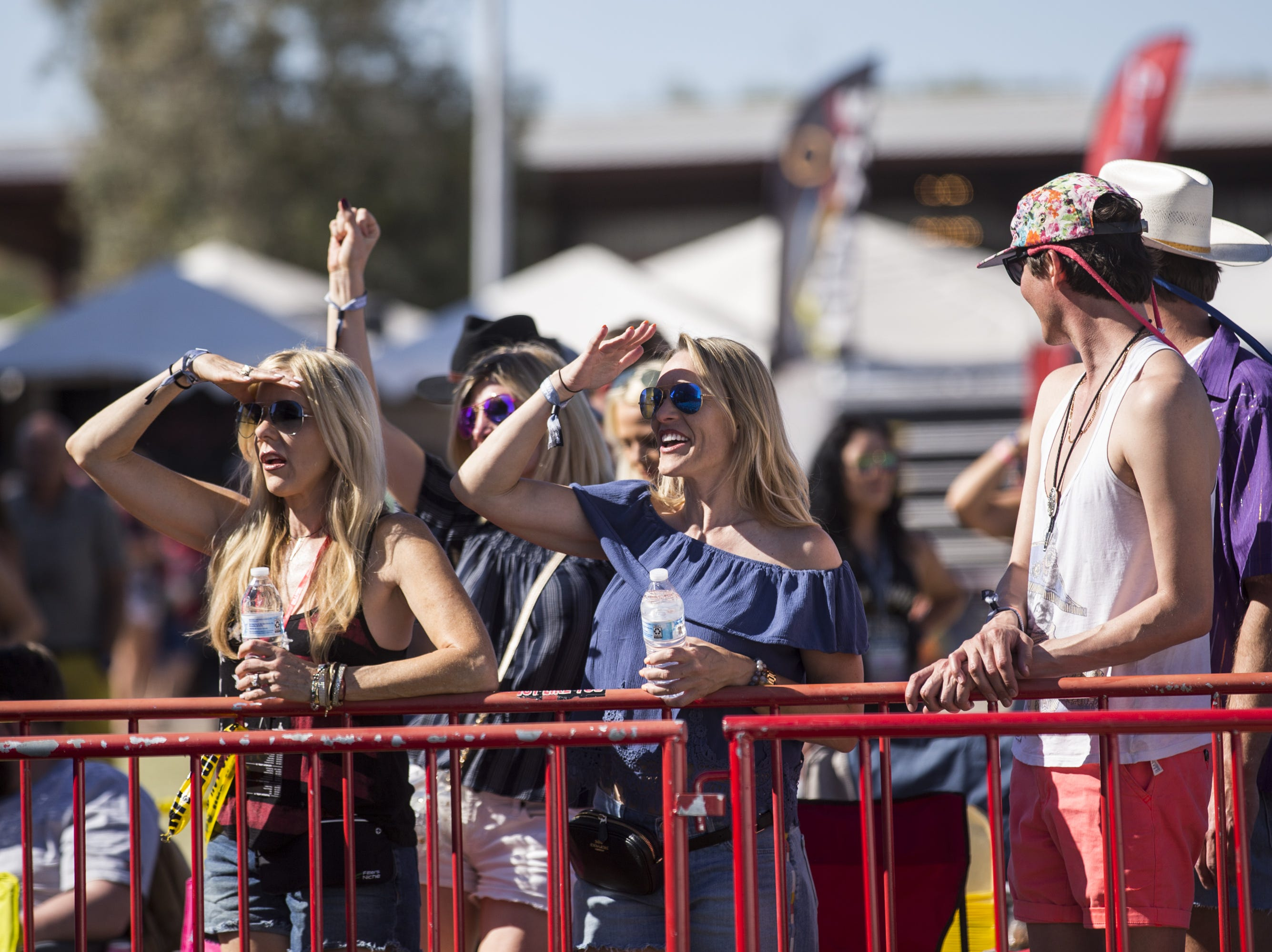 Fans watch Austin Burke perform on Saturday, April 13, 2019, during Day 3 of Country Thunder Arizona in Florence, Arizona.