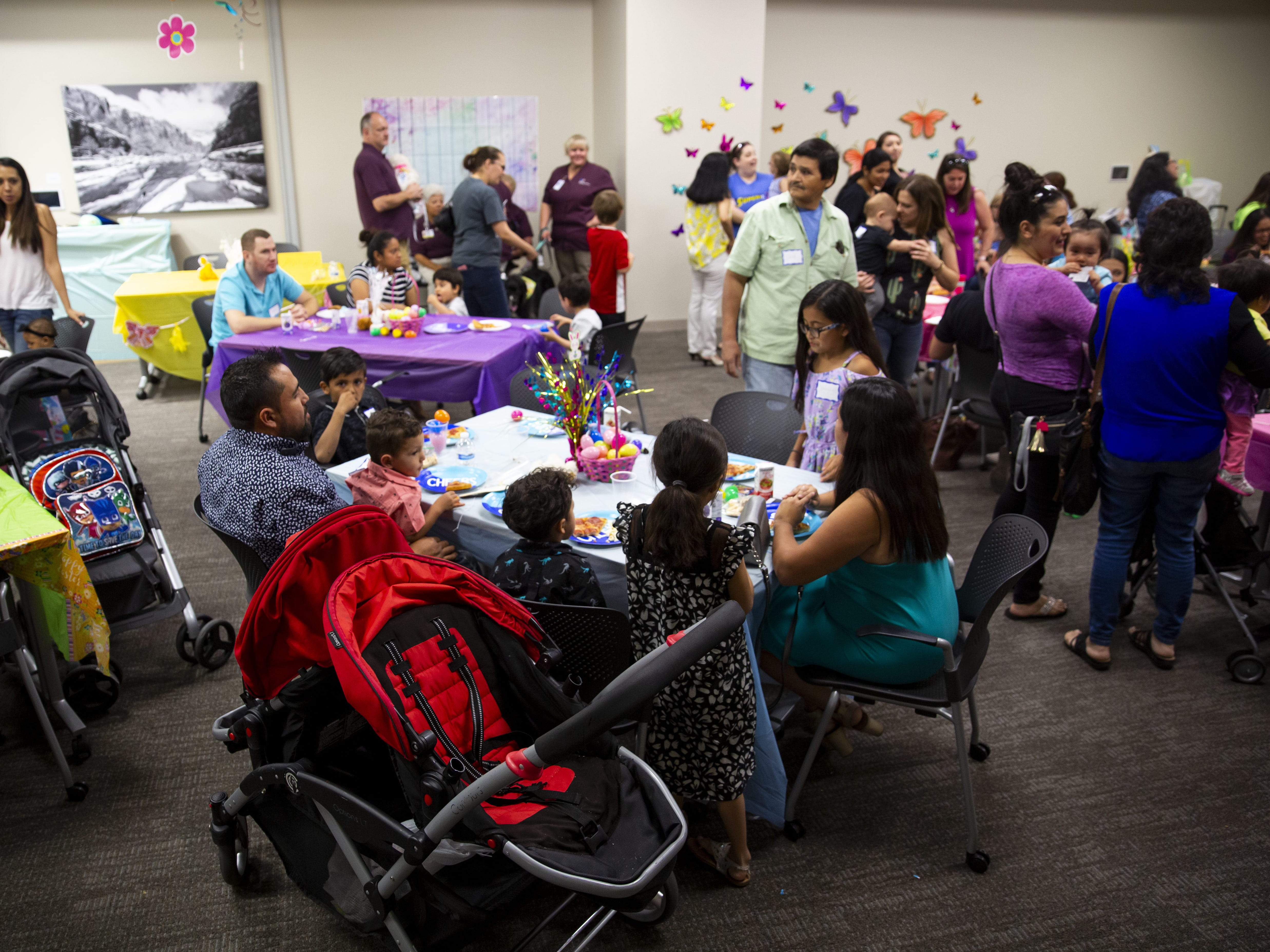 Families eat pizza and snacks at the Preemie NICU Reunion at Banner University Medical Center on April 13, 2019.