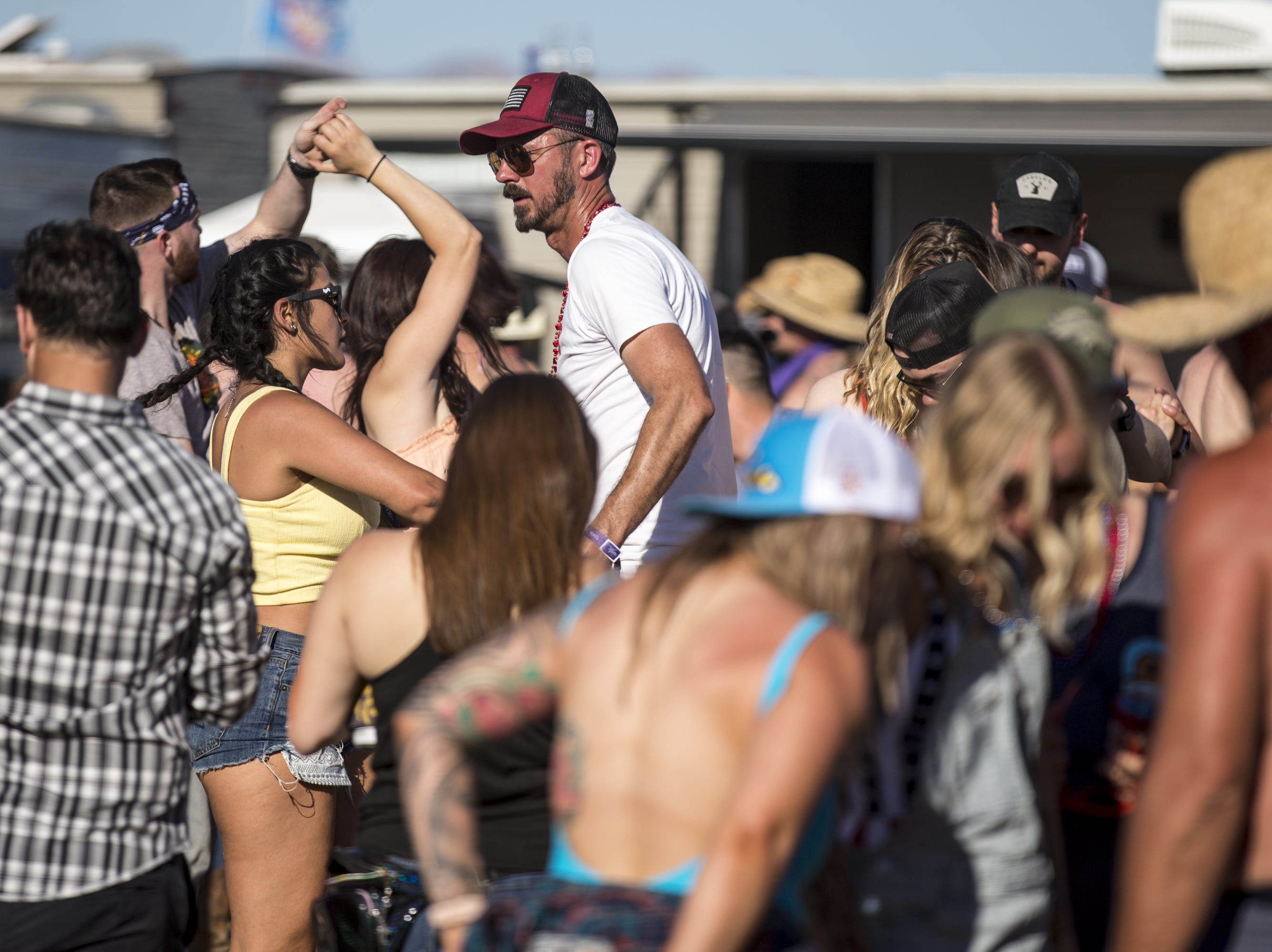 Festivalgoers dance at the Crazy Coyote campground on Saturday, Apr. 13, 2019, during Day 3 of Country Thunder Arizona in Florence, Ariz.