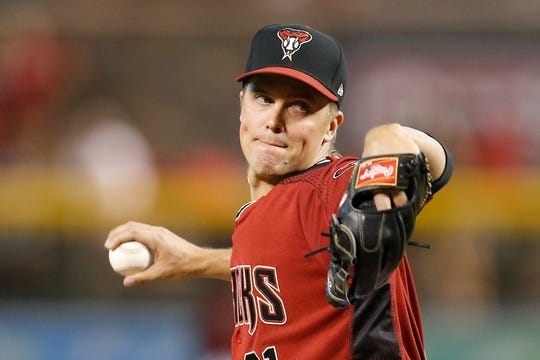 Zack Greinke pitches in the first inning of Sunday's win over the Padres.