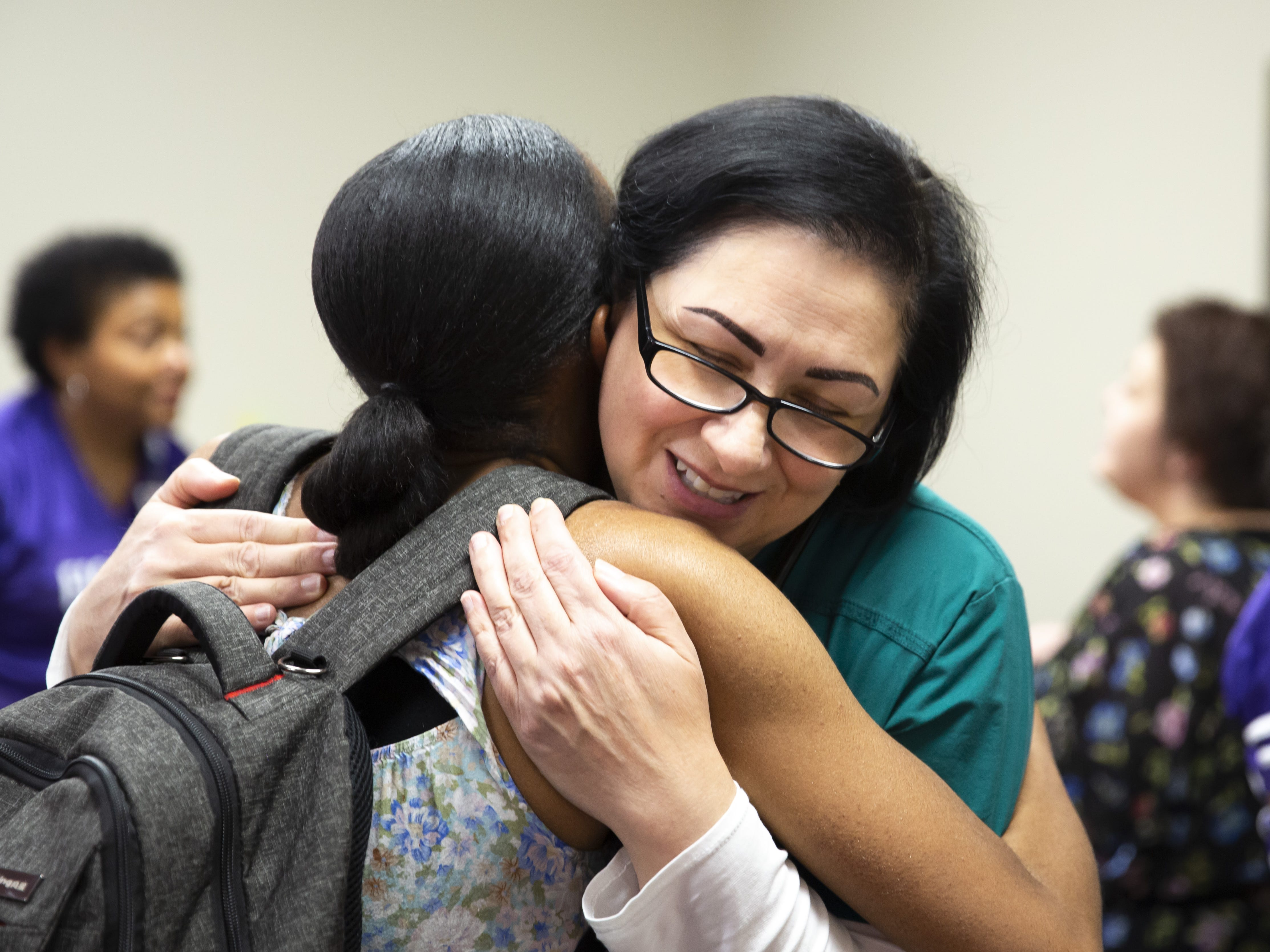 Respiratory therapist Deb Hall hugs Shay Craig, a mother of quadruplets, at the Preemie NICU Reunion at Banner University Medical Center on April 13, 2019.
