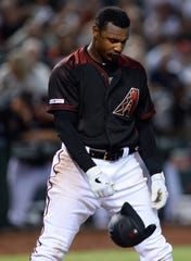 Apr 13, 2019; Phoenix, AZ, USA; Arizona Diamondbacks center fielder Adam Jones (10) reacts after striking out against the San Diego Padres during the second inning at Chase Field. Mandatory Credit: Joe Camporeale-USA TODAY Sports