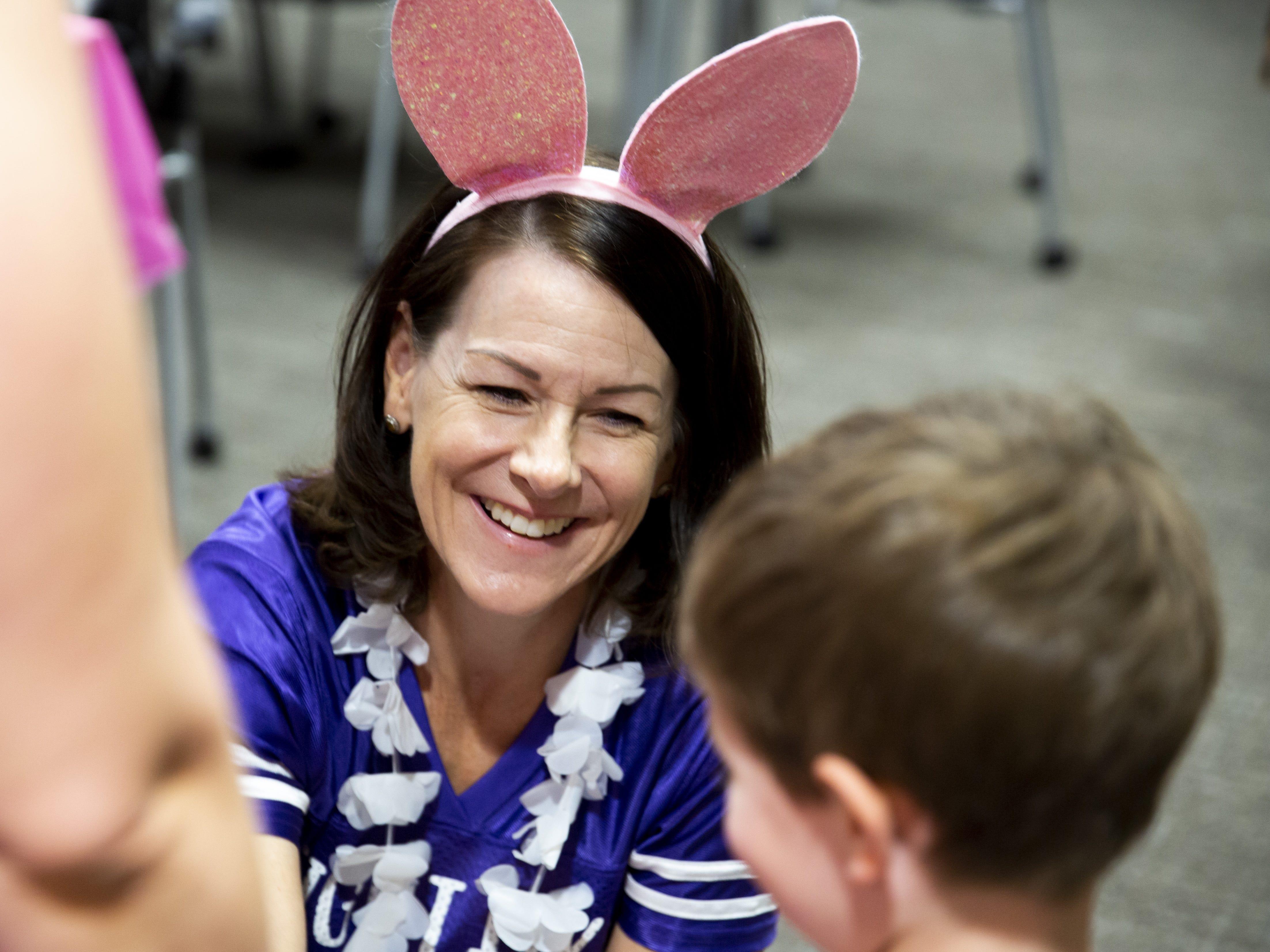 Registered nurse Kirsten Phillips greets children at the Preemie NICU Reunion at Banner University Medical Center on April 13, 2019.