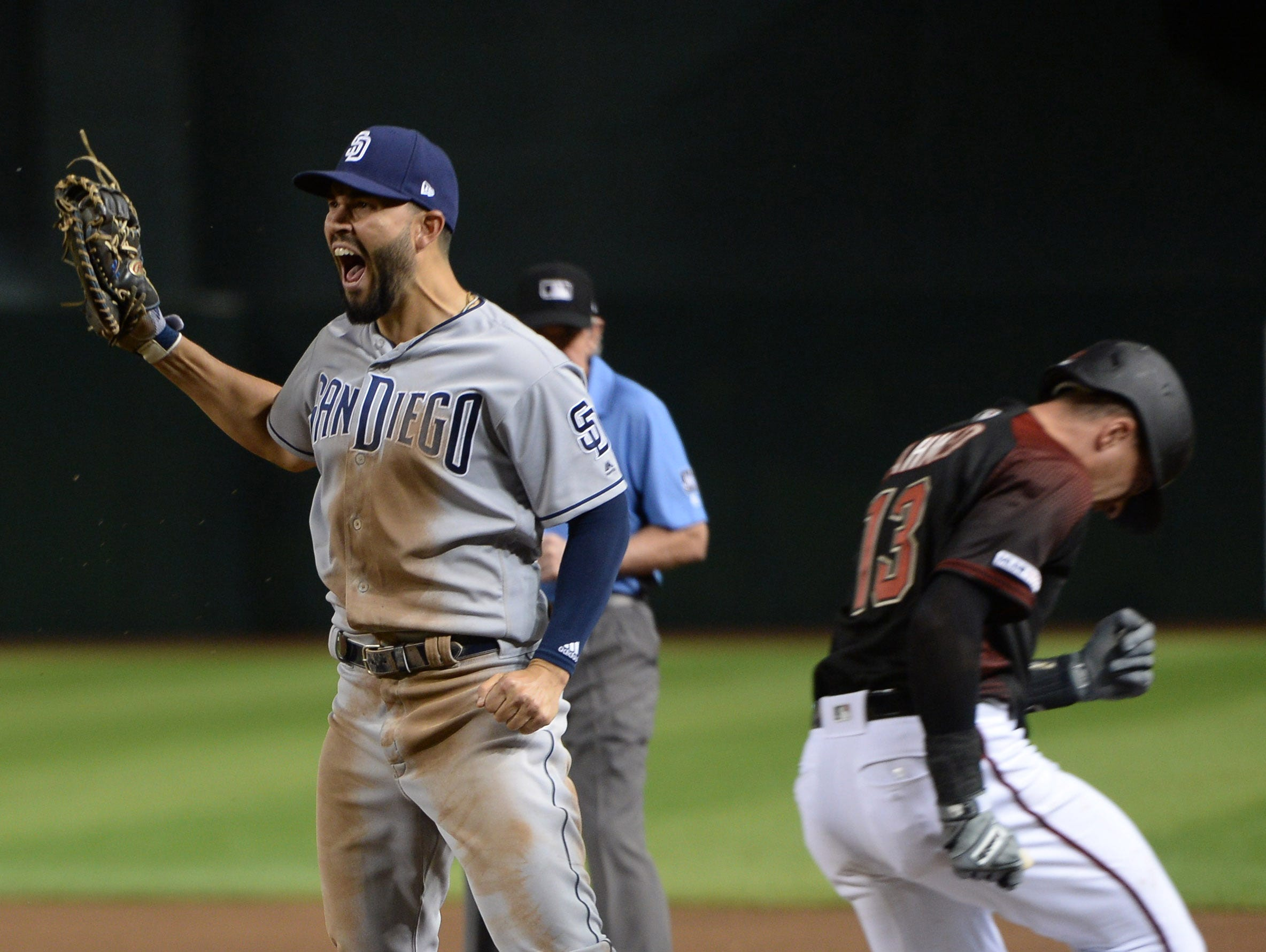 Apr 13, 2019; Phoenix, AZ, USA; San Diego Padres first baseman Eric Hosmer (30) reacts after forcing out Arizona Diamondbacks shortstop Nick Ahmed (13) on the back end of a double play during the seventh inning at Chase Field. Mandatory Credit: Joe Camporeale-USA TODAY Sports