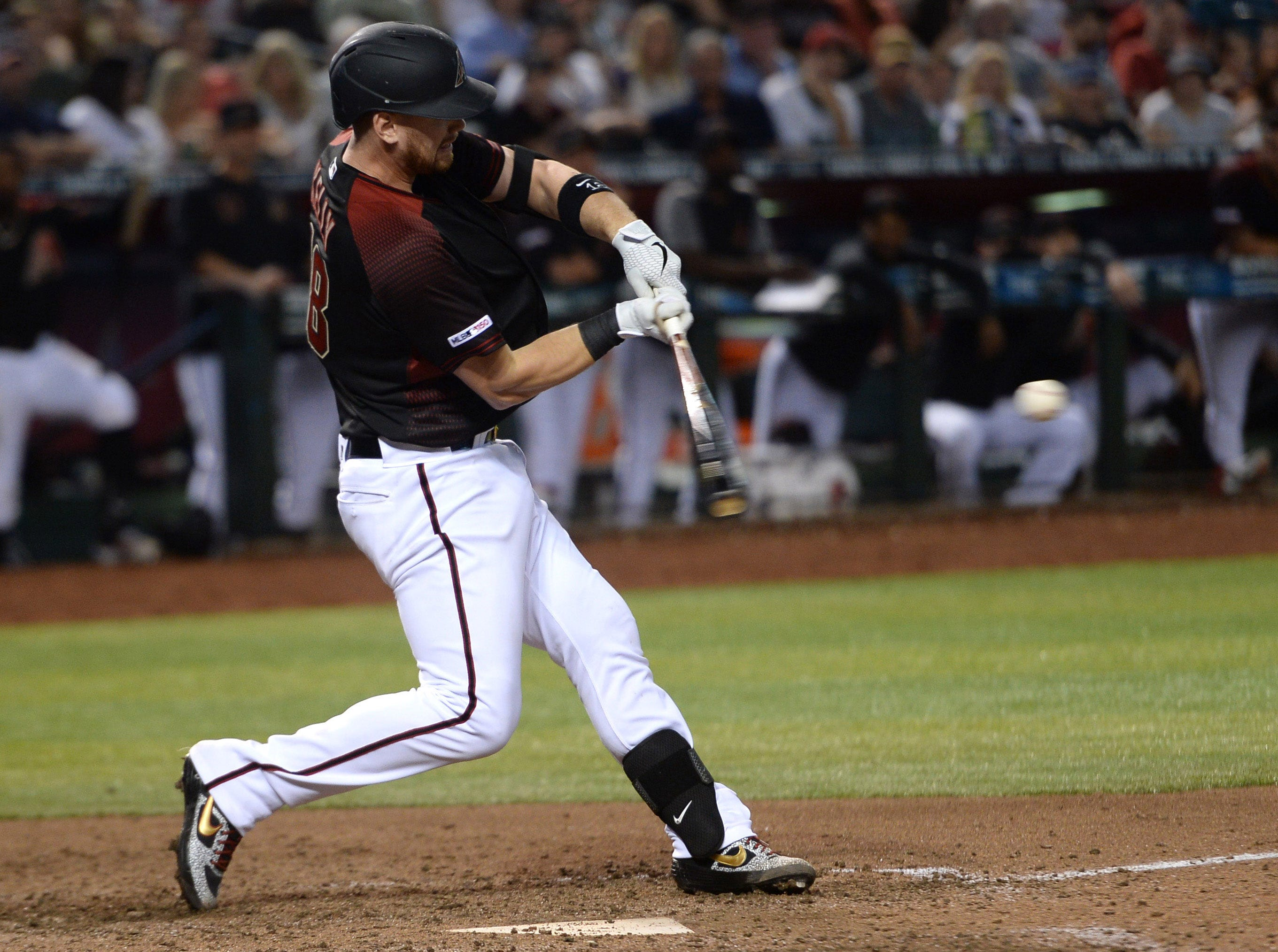 Apr 13, 2019; Phoenix, AZ, USA; Arizona Diamondbacks catcher Carson Kelly (18) hits an RBI single against the San Diego Padres during the sixth inning at Chase Field. Mandatory Credit: Joe Camporeale-USA TODAY Sports