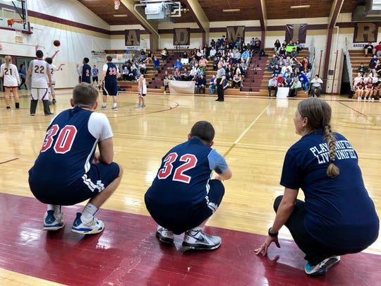 Wappingers unified basketball players Luke Mahon and Tyler Hall, set to check in, get instructions from coach Kerri Walsh during Friday's game at Arlington.
