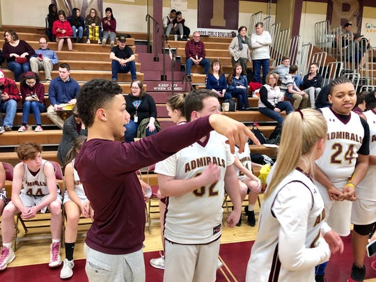 Arlington assistant coach Kwincey Pease, a football player, gives instructions to the Admirals unified basketball team during Friday's game against Wappingers.