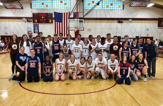The players and coaches of the Arlington and Wappingers district unified basketball teams pose together after Friday's game.
