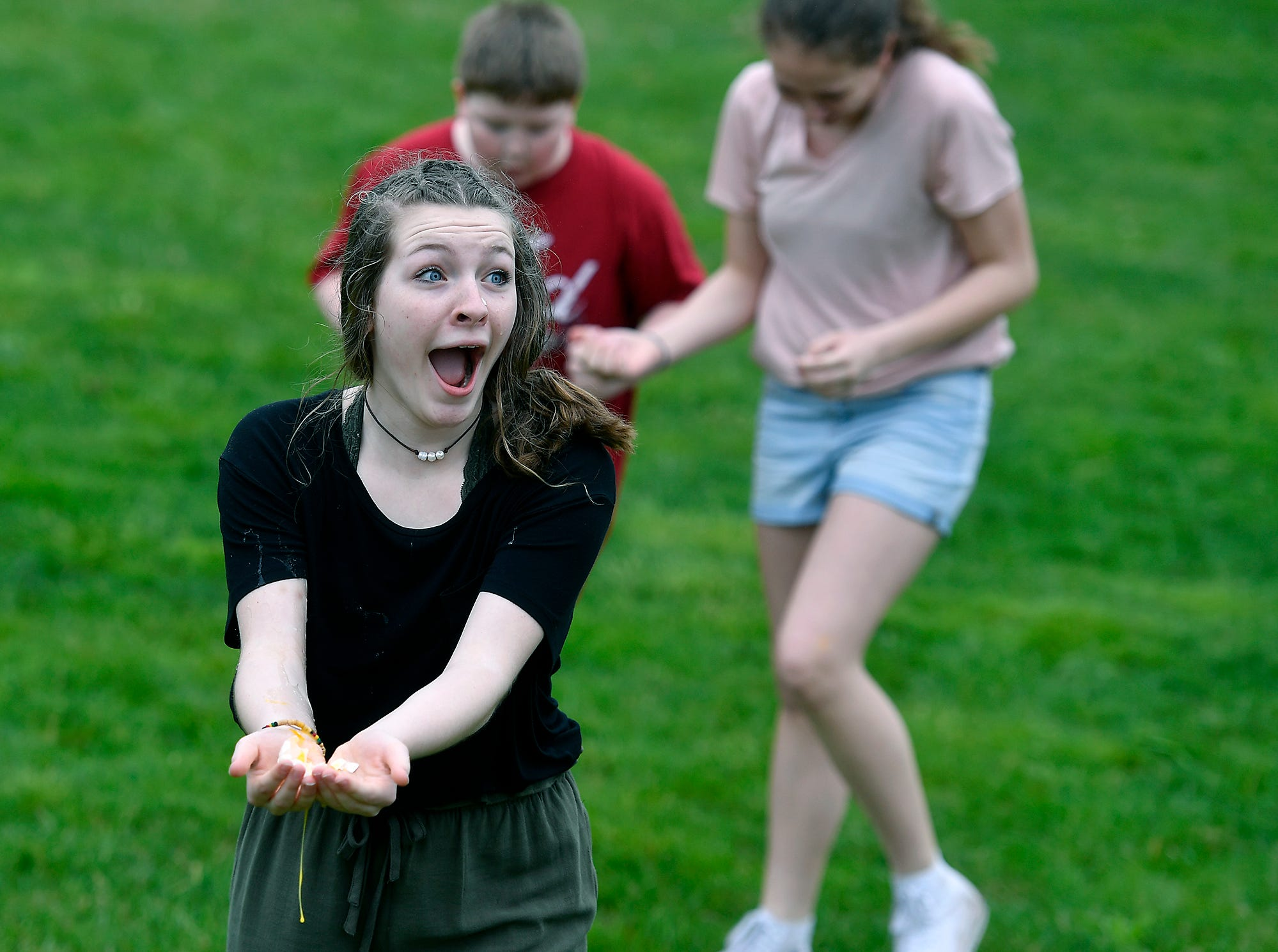 Presley Beal, 13, reacts as her egg shatters in her hands during an egg toss before the egg hunt at Genesis Church in Seven Valleys, Sunday, April 14, 2019.John A. Pavoncello photo