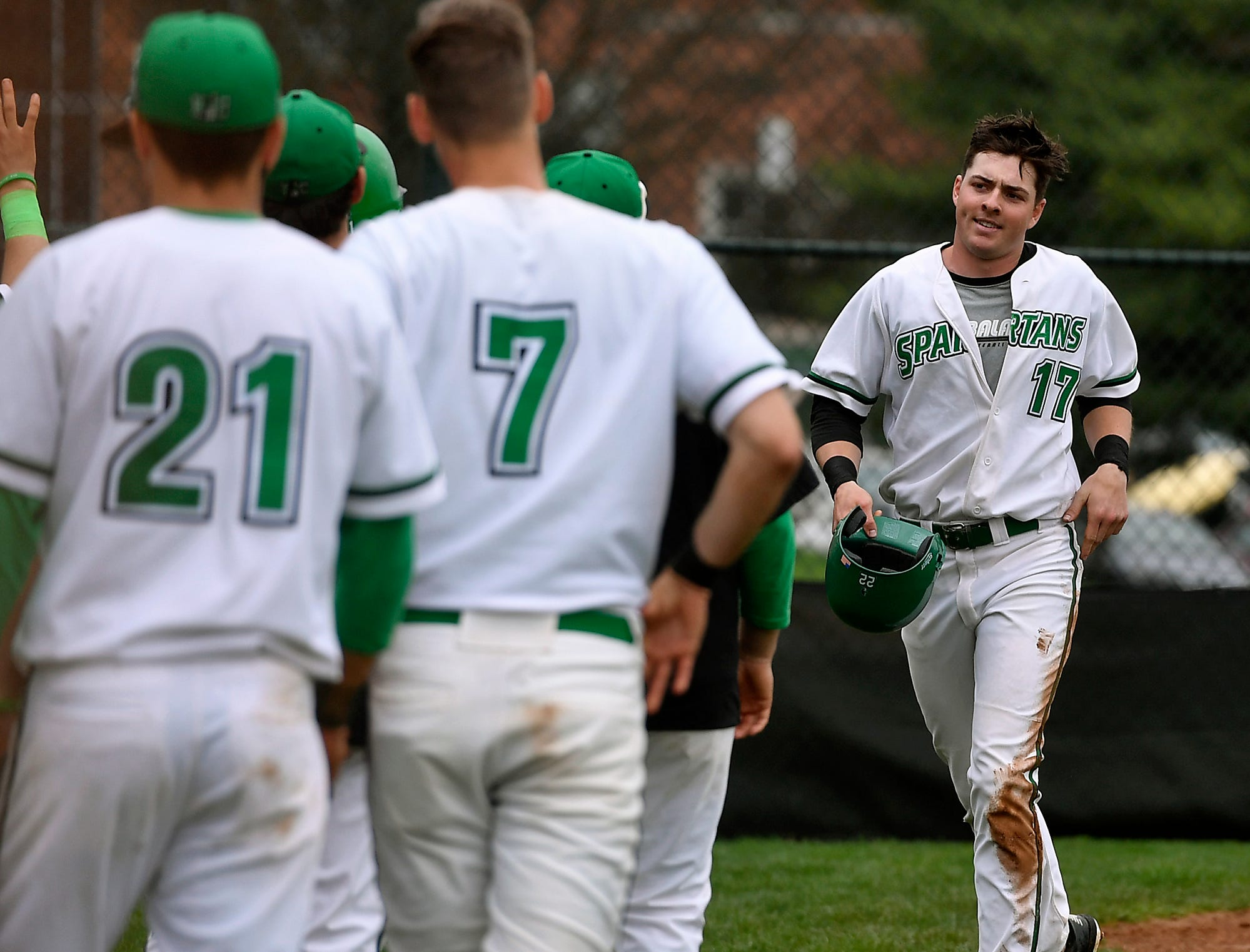 Grant Oberholtzer of York College is greeted by his teammates after connecting with a solo homerun against Rudgers Camden in the sixth inning, Sunday, April 14, 2019.John A. Pavoncello photo