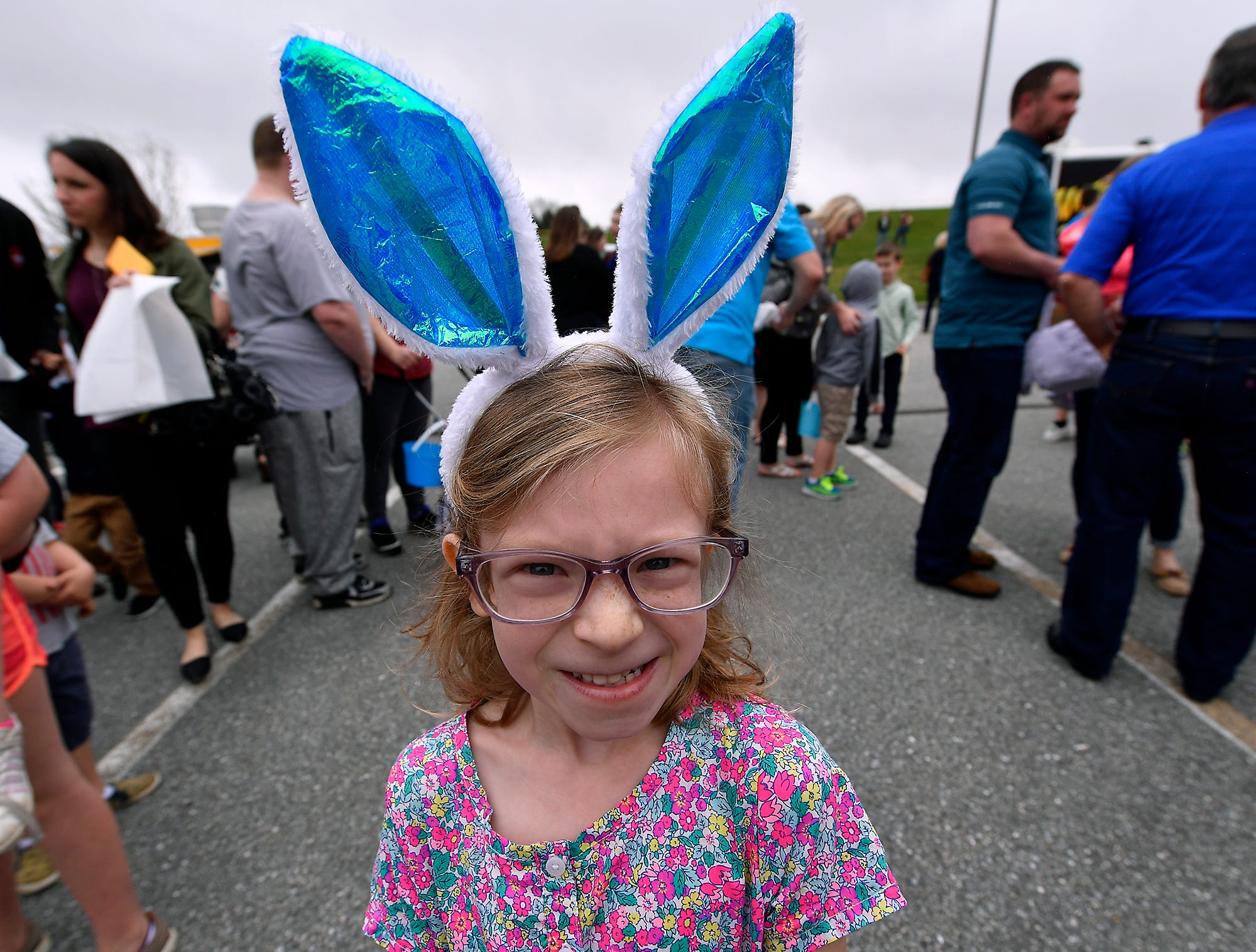 Sophie Amspacker, 6 of  York New Salem, wears bunny ears while waiting for the start of the first ever Easter Egg Hunt at Genesis Church in Seven Valleys, Sunday, April 14, 2019. More than 2,000 people participated in the event.John A. Pavoncello photo