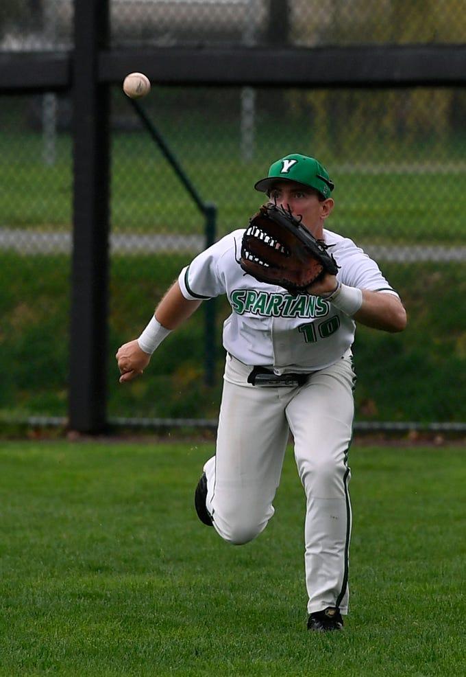 York College right fielder Brandon White runs down a fly ball from Matthew Stoots of Rudgers Camden, Sunday, April 14, 2019.John A. Pavoncello photo
