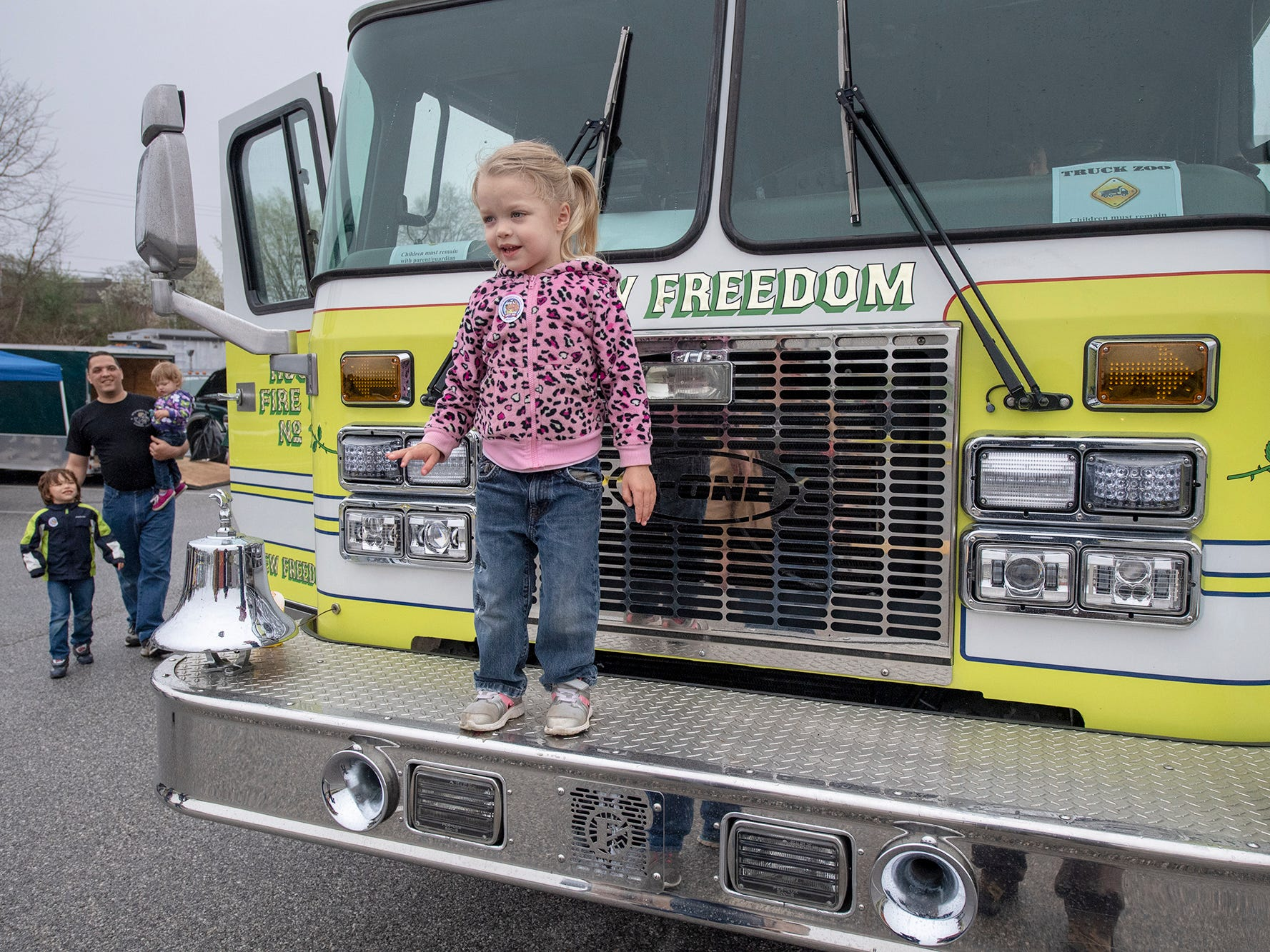 Paige Lombardo, age 3 of Conewago Township, has her picture taken on a fire engine from New Freedom during the Truck Zoo at Paul Smith Library of Southern York County.