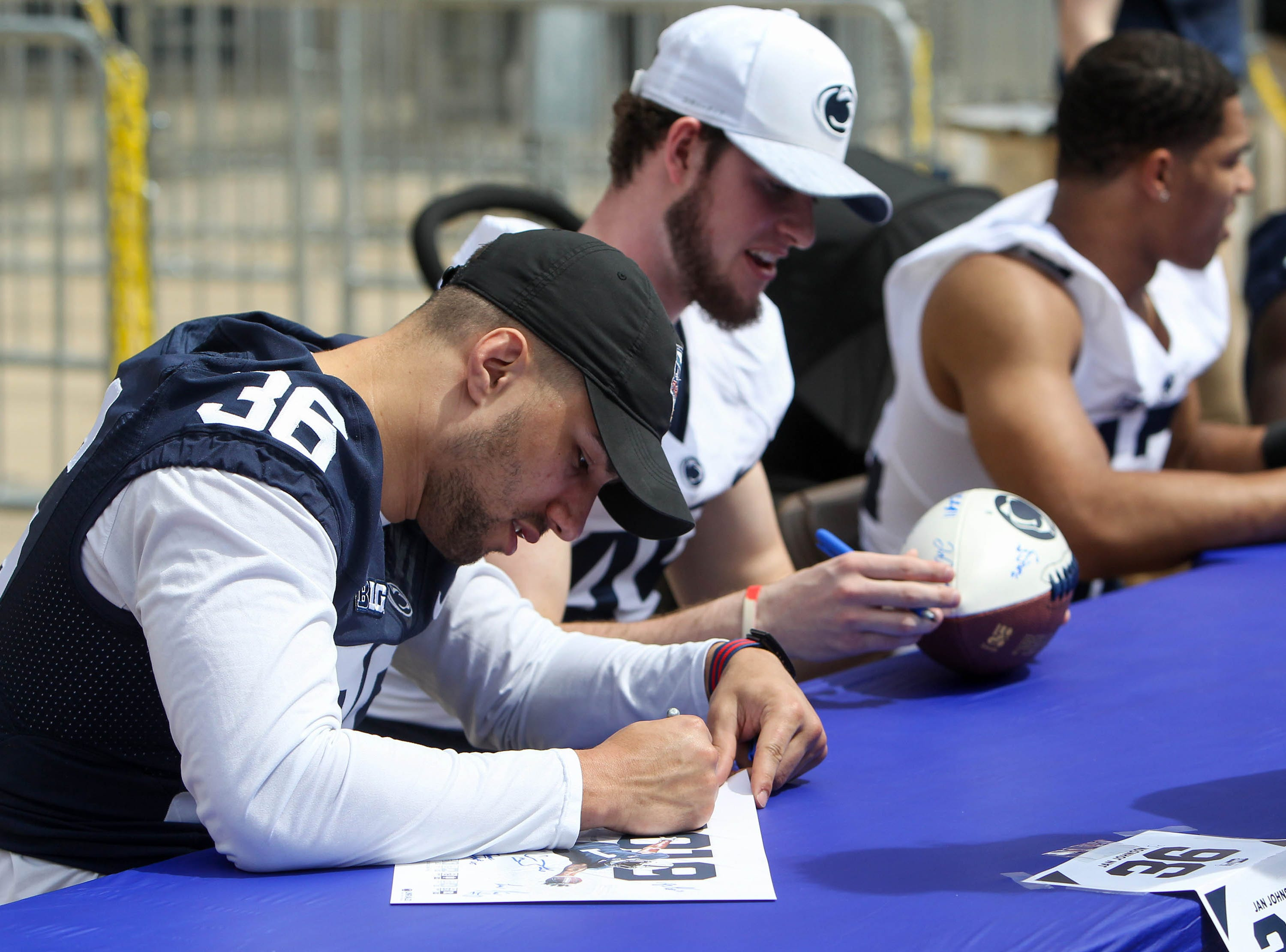 Apr 13, 2019; University Park, PA, USA; Penn State Nittany Lions linebacker Jan Johnson (36) signs an autograph for a fan prior to the Blue White spring game at Beaver Stadium. Mandatory Credit: Matthew O'Haren-USA TODAY Sports