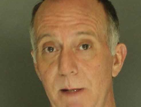 Bruce Edens, arrested for terroristic threats and harassment.