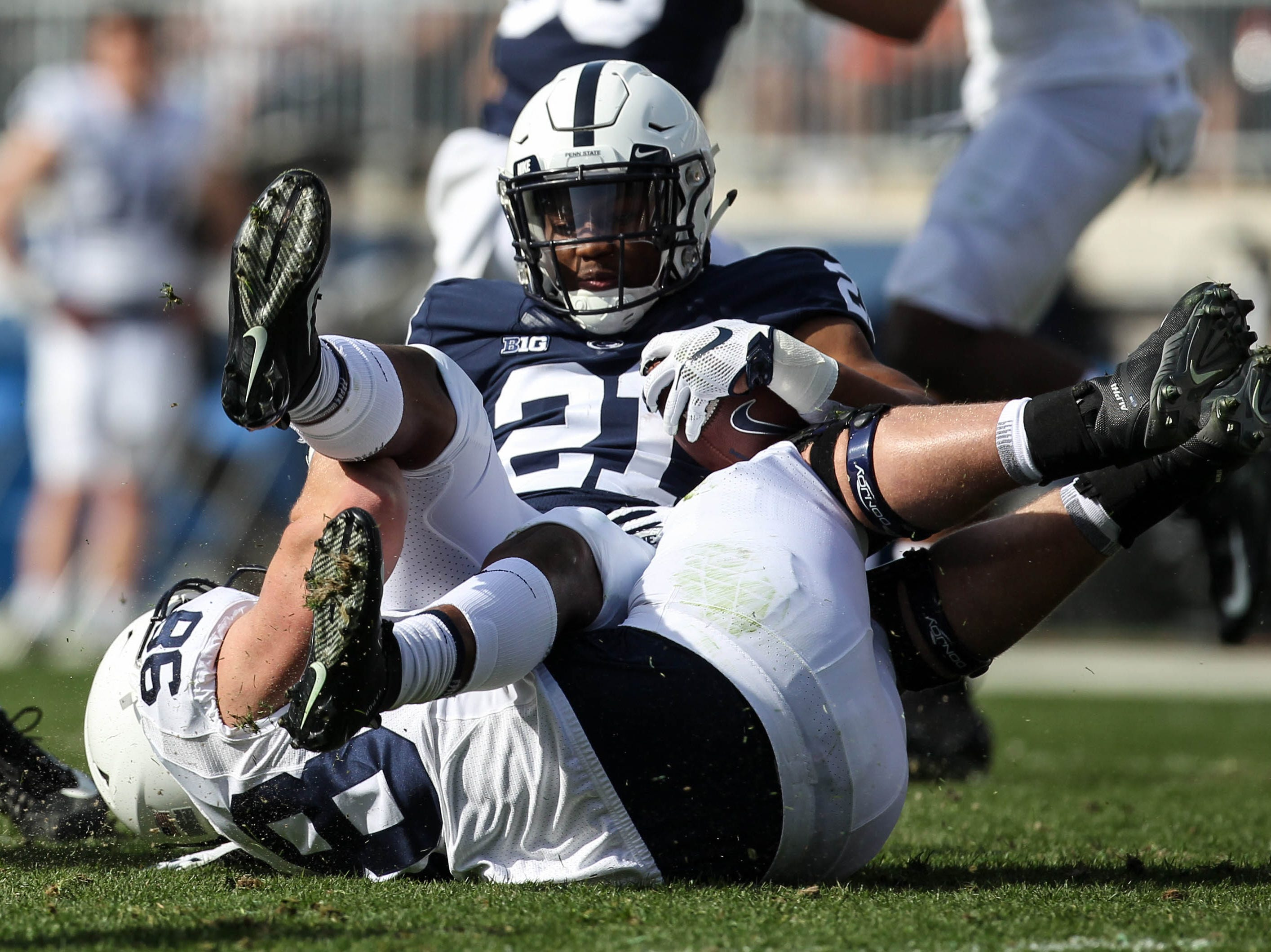 Apr 13, 2019; University Park, PA, USA; Penn State Nittany Lions running back Noah Cain (21) during the third quarter of the Blue White spring game at Beaver Stadium. The Blue team defeated the White team 24-7. Mandatory Credit: Matthew O'Haren-USA TODAY Sports