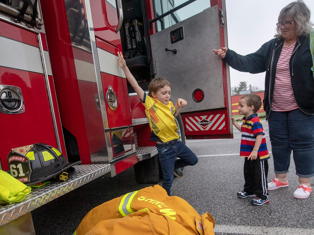 Shrewsbury Volunteer Fire Company let children try on turnout gear during the Truck Zoo at Paul Smith Library of Southern York County.