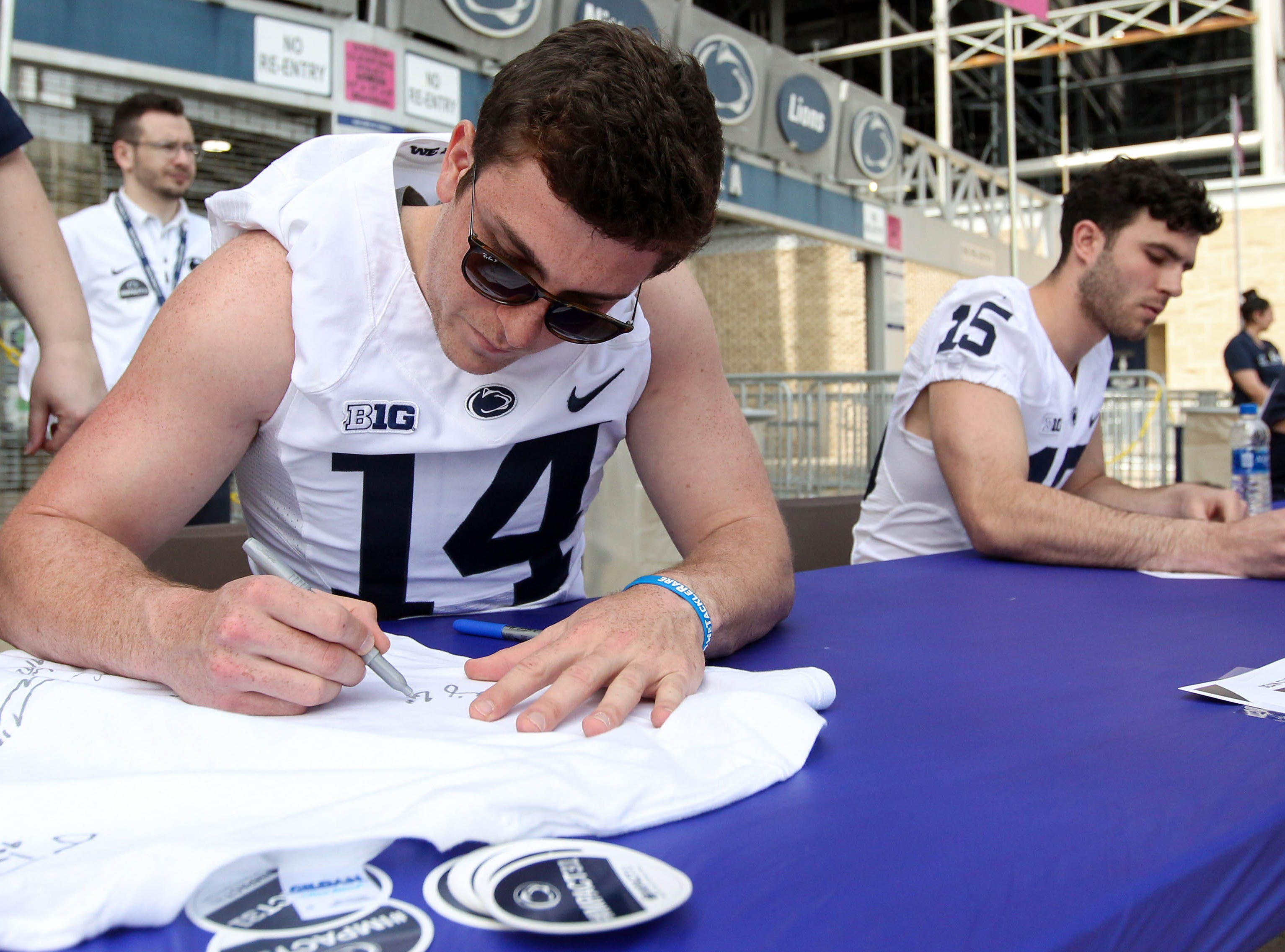 Apr 13, 2019; University Park, PA, USA; Penn State Nittany Lions quarterback Sean Clifford (14) signs an autograph for a fan prior to the Blue White spring game at Beaver Stadium. Mandatory Credit: Matthew O'Haren-USA TODAY Sports