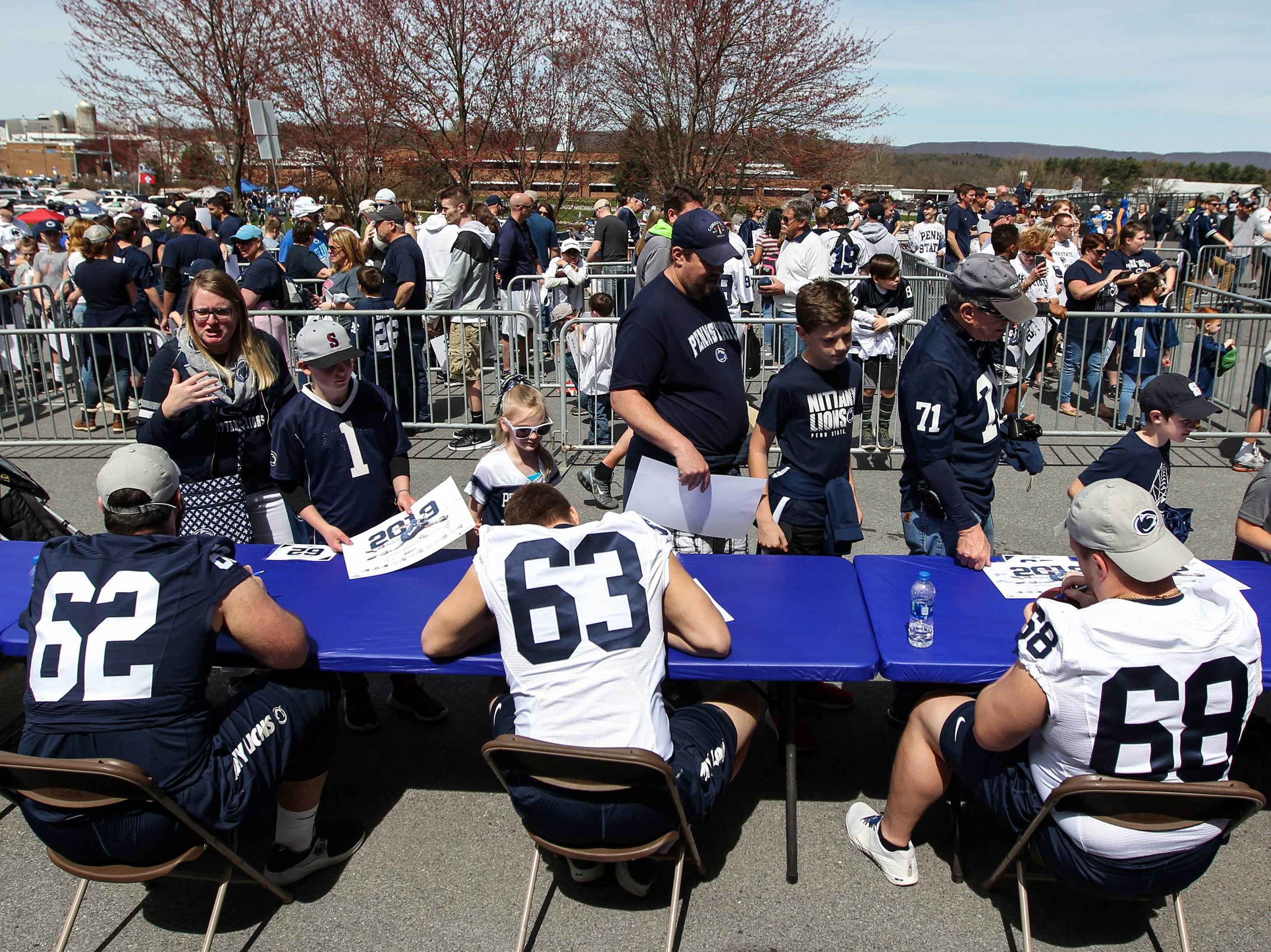 Apr 13, 2019; University Park, PA, USA; Penn State Nittany Lion players sign autographs for fans prior to the Blue White spring game at Beaver Stadium. Mandatory Credit: Matthew O'Haren-USA TODAY Sports