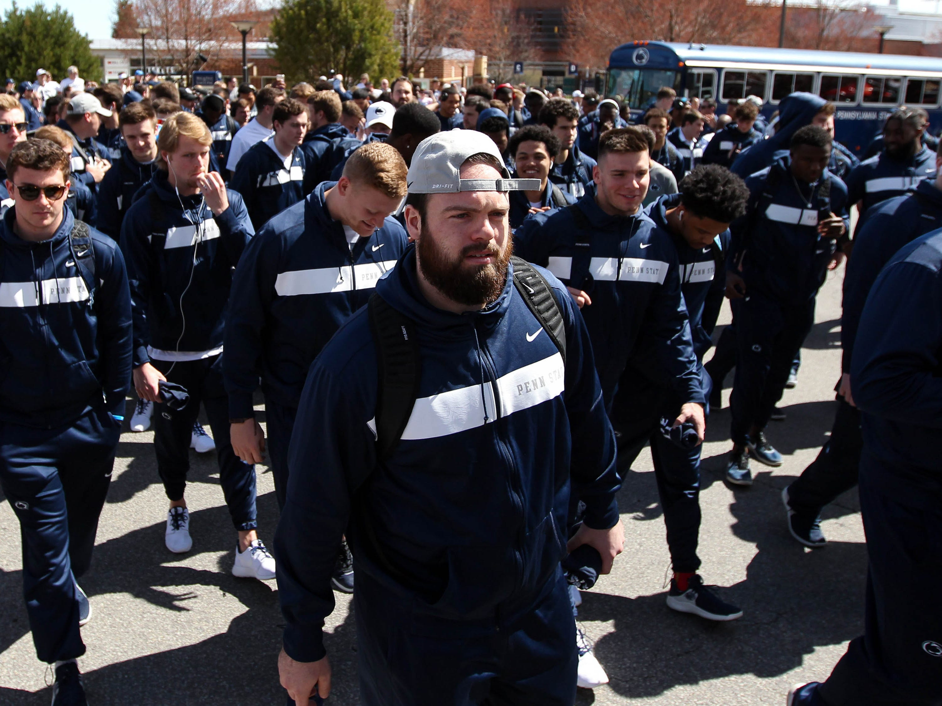 Apr 13, 2019; University Park, PA, USA; Penn State Nittany Lion players exit the team bus prior to the Blue White spring game at Beaver Stadium. Mandatory Credit: Matthew O'Haren-USA TODAY Sports