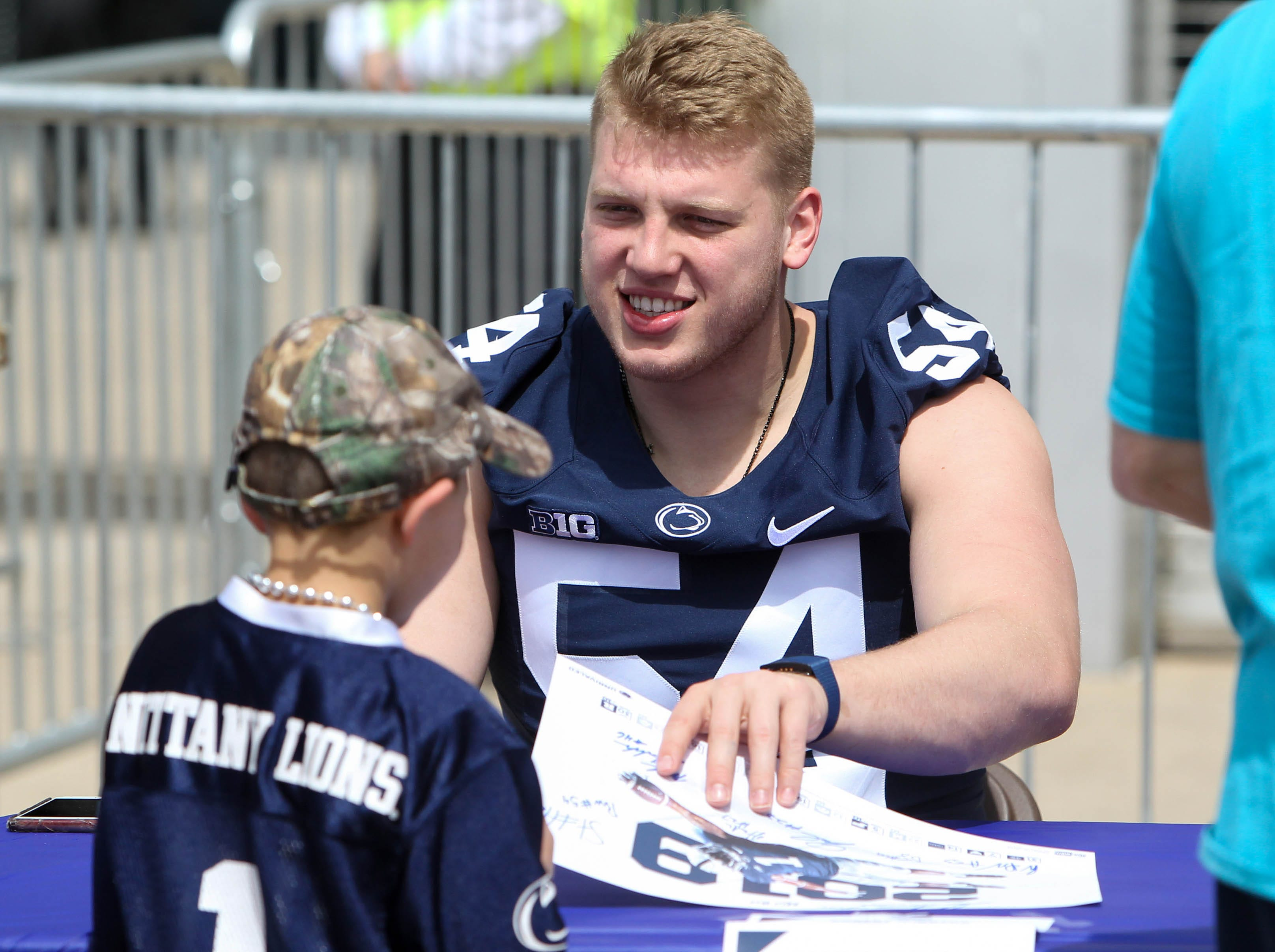 Apr 13, 2019; University Park, PA, USA; Penn State Nittany Lions defensive tackle Robert Windsor (54) signs an autograph for a fan prior to the Blue White spring game at Beaver Stadium. Mandatory Credit: Matthew O'Haren-USA TODAY Sports