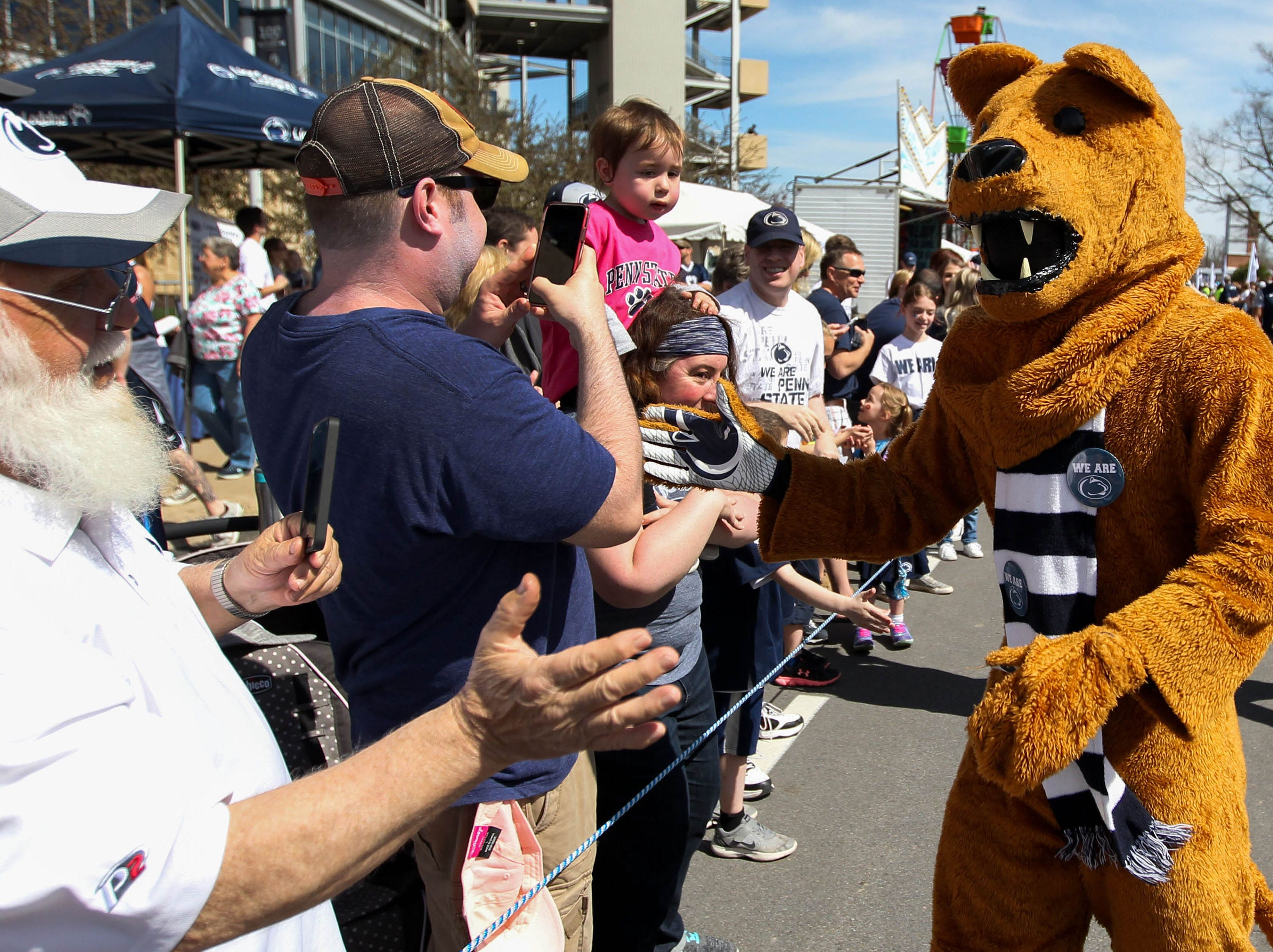 Apr 13, 2019; University Park, PA, USA; The Penn State Nittany Lions mascot shakes hands with fans prior to the Blue White spring game at Beaver Stadium. Mandatory Credit: Matthew O'Haren-USA TODAY Sports