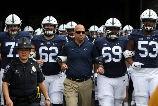 Penn State Nittany Lions head coach James Franklin leads his team to the field prior to the Blue-White spring game at Beaver Stadium.