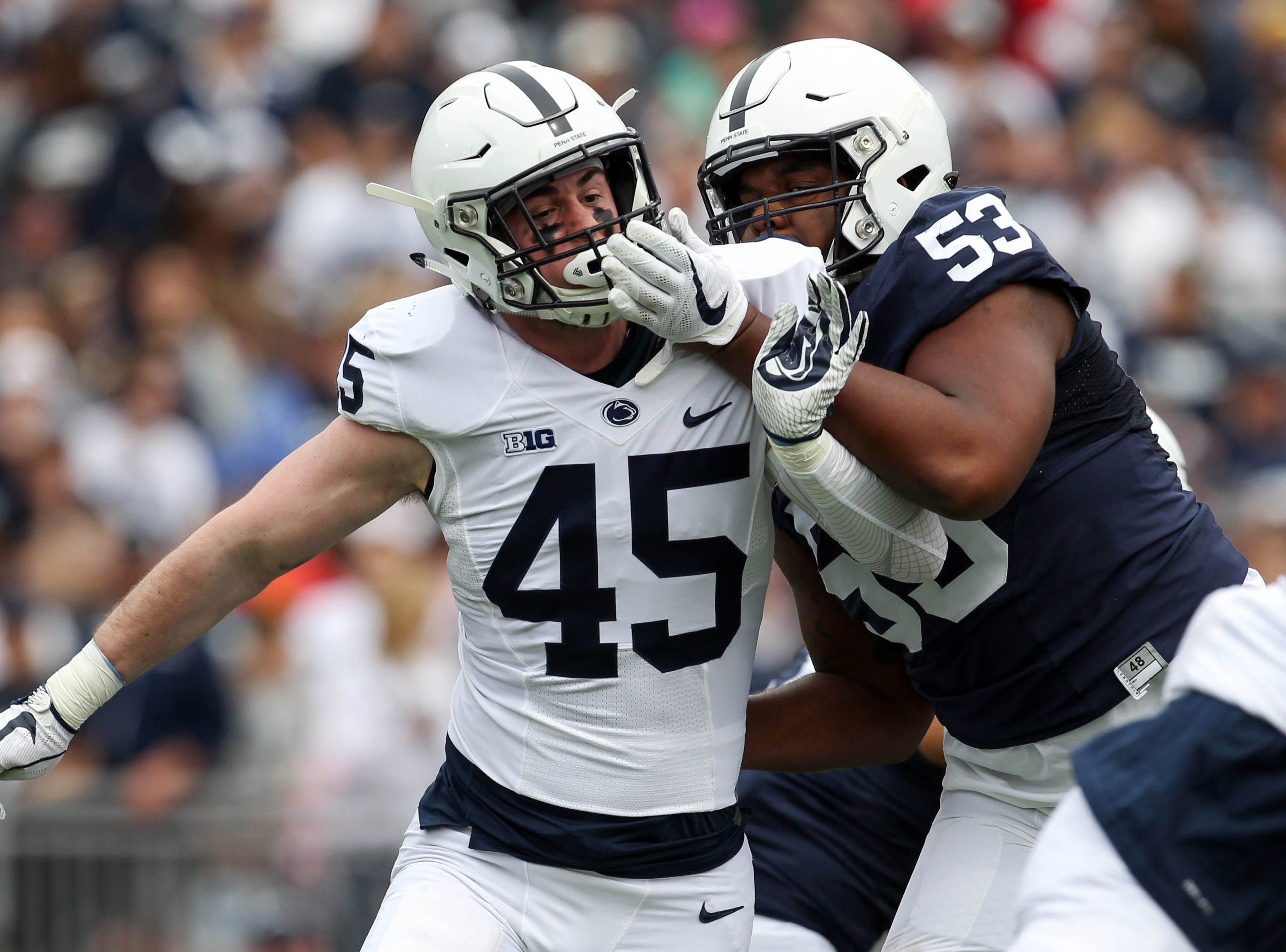 Apr 13, 2019; University Park, PA, USA; Penn State Nittany Lions linebacker Charlie Katshir (45) attempts to break past offensive linesmen Rasheed Walker (53) during the first quarter of the Blue White spring game at Beaver Stadium. The Blue team defeated the White team 24-7. Mandatory Credit: Matthew O'Haren-USA TODAY Sports