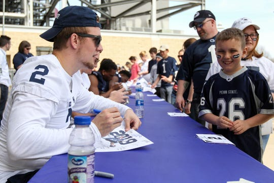 Apr 13, 2019; University Park, PA, USA; Penn State Nittany Lions quarterback Tommy Stevens (2) signs an autograph for a fan prior to the Blue White spring game at Beaver Stadium. Mandatory Credit: Matthew O'Haren-USA TODAY Sports