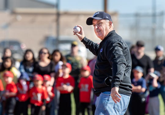 Jim Sandford throws out the first pitch.
