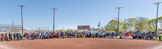 T-ball and farm teams line up around the infield during opening ceremonies.