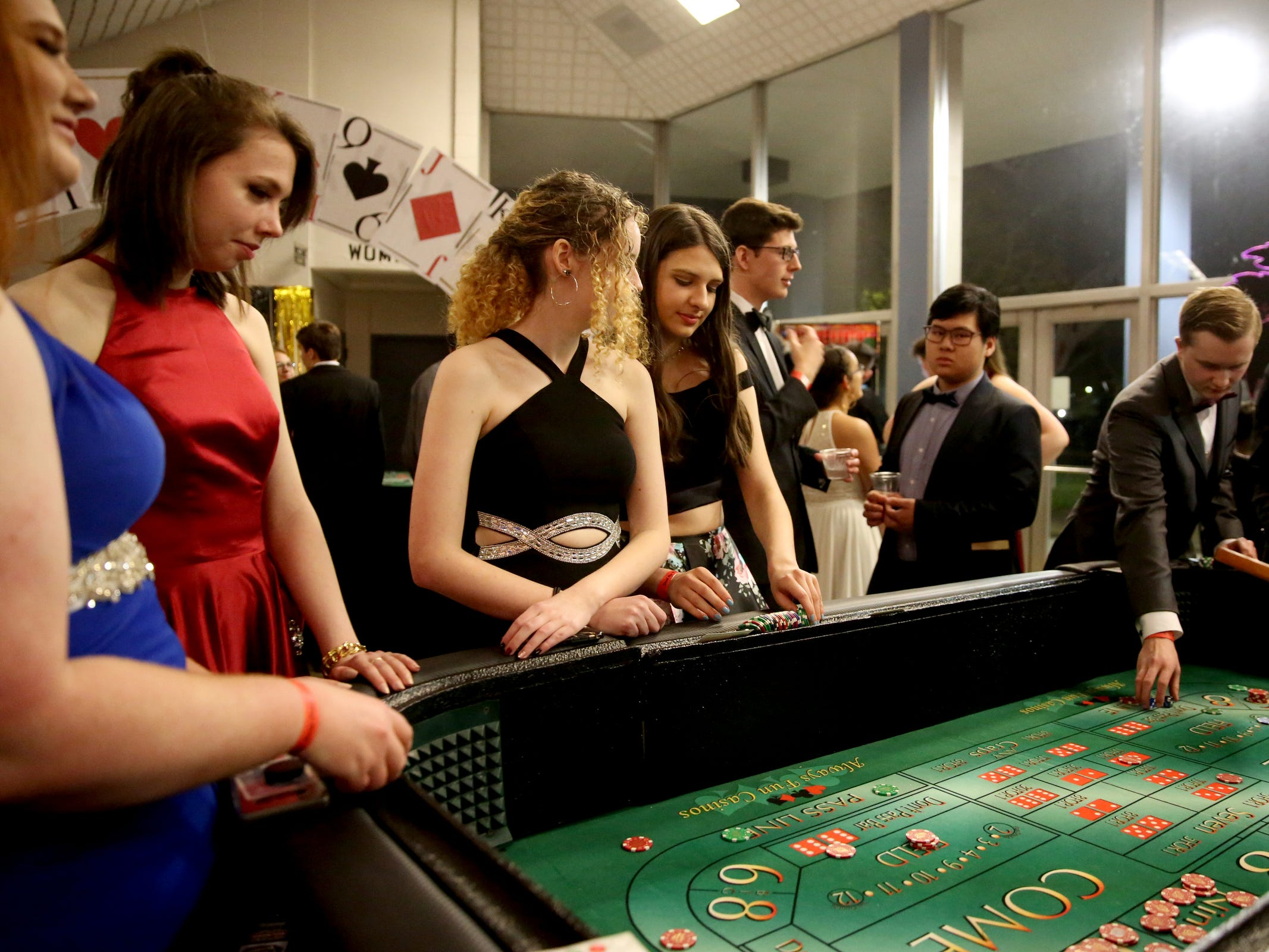 Students play Vegas-style games during the West Salem High School prom at Salem Armory Auditorium on April 13, 2019.
