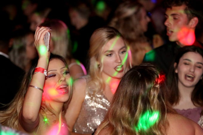 Students dance during the West Salem High School prom at Salem Armory Auditorium on April 13, 2019.