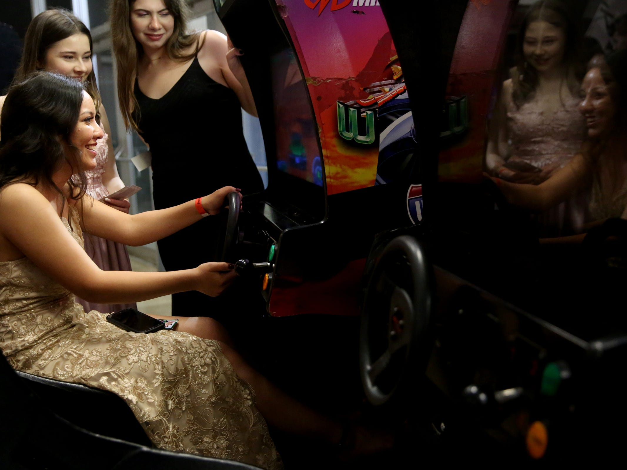 Chrissa Wilkie, a senior, plays a racing game during the West Salem High School prom at Salem Armory Auditorium on April 13, 2019.
