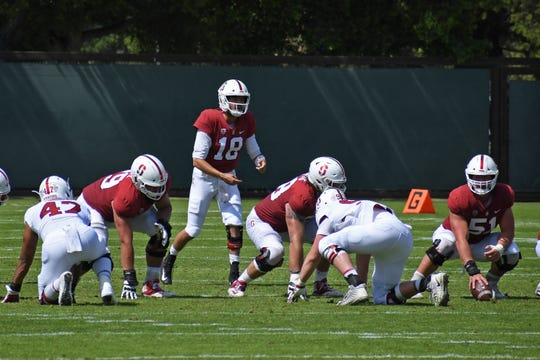 Palma graduates Jack Richardson (18) and Drew Dalman (51) took to the field Saturday for the Cardinal's annual spring game.