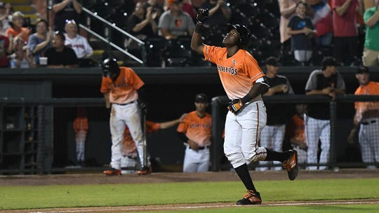 Jean Carlos Encarnacion celebrates after his walkoff grand slam to defeat the Lakewood BlueClaws on Saturday night at Perdue Stadium.