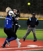 Evangel's Taylor Mayo collides with a Calvary player in a game earlier this season.