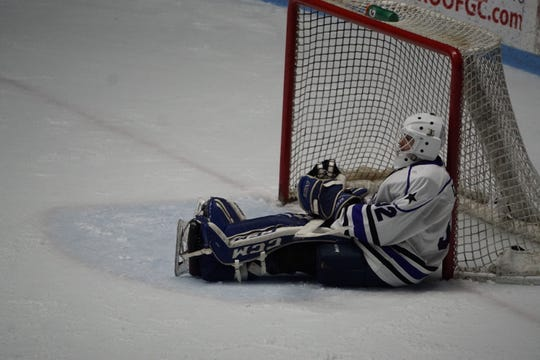 Lone Star goaltender Seth Eisele sits in disbelief with the pick behind him after Warren Natyshak's go-ahead goal late in the third period helped the Shereveport Mudbugs tie a South Division semifinal series Saturday.