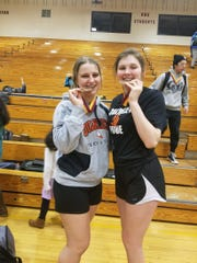 Hannah Fletcher (left) and Jamie Huygens with their medals after the state powerlifting meet on March 23 at Sioux Falls Roosevelt High School.
