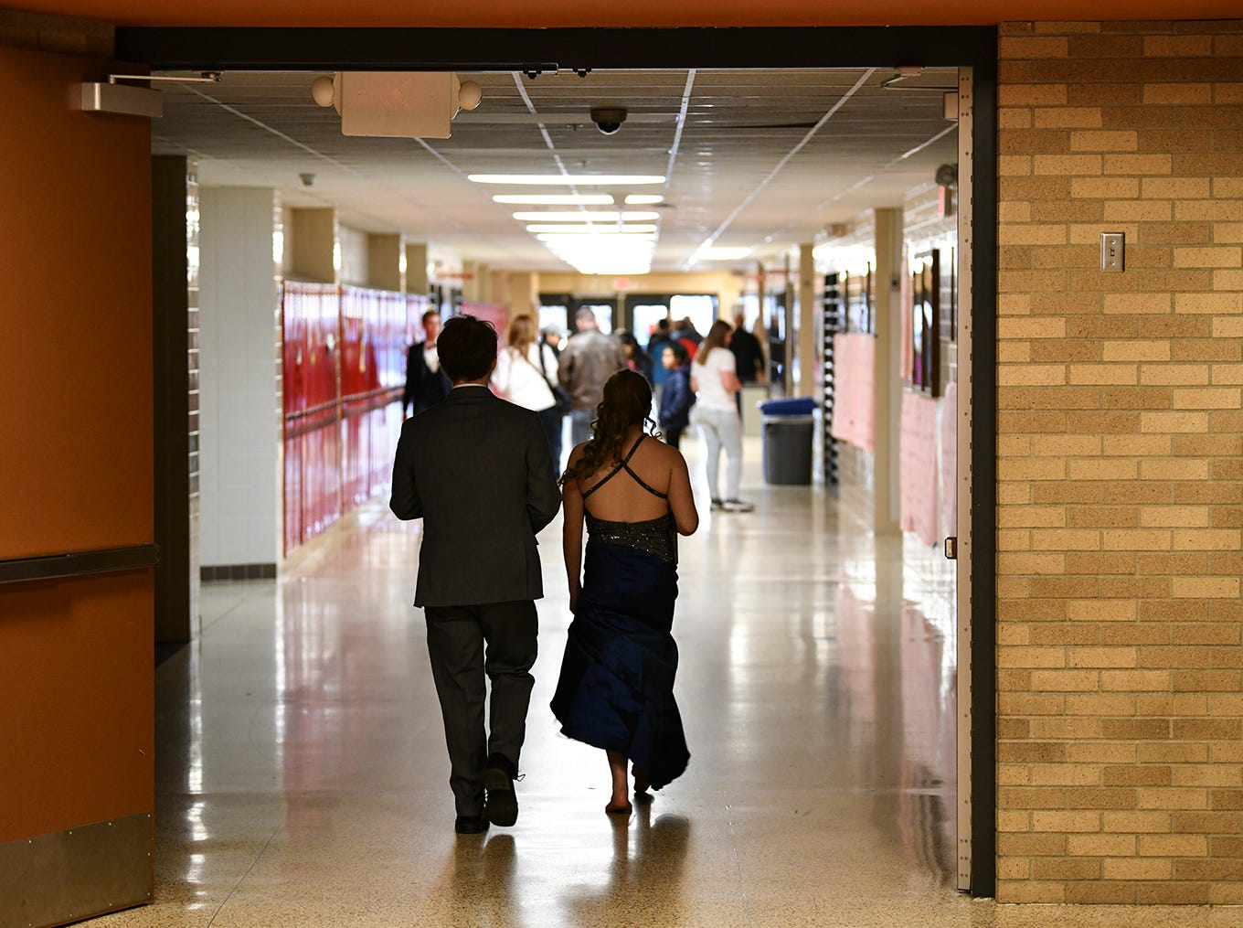 Promgoers leave the gymnasium following prom grand march Saturday, April 13, at ROCORI High School in Cold Spring.