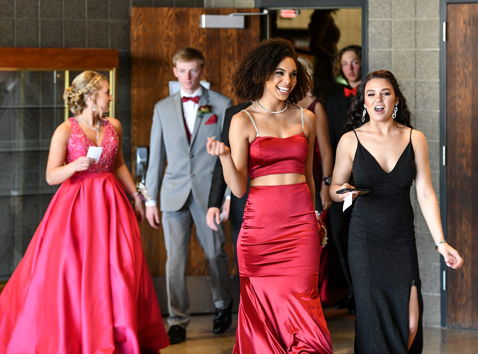 Couples get ready to start prom grand march Saturday, April 13, at ROCORI High School in Cold Spring.