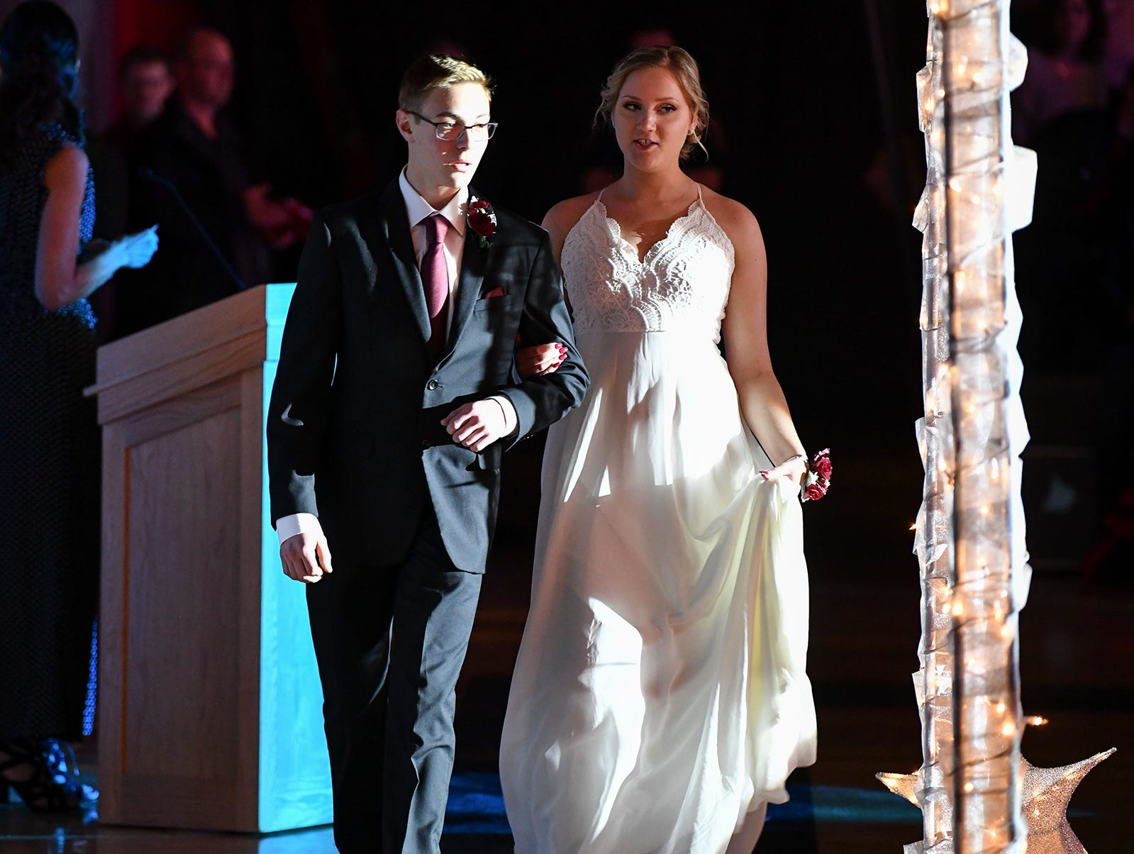 A couple is lit by spotlight during their turn at prom grand march Saturday, April 13, at ROCORI High School in Cold Spring.